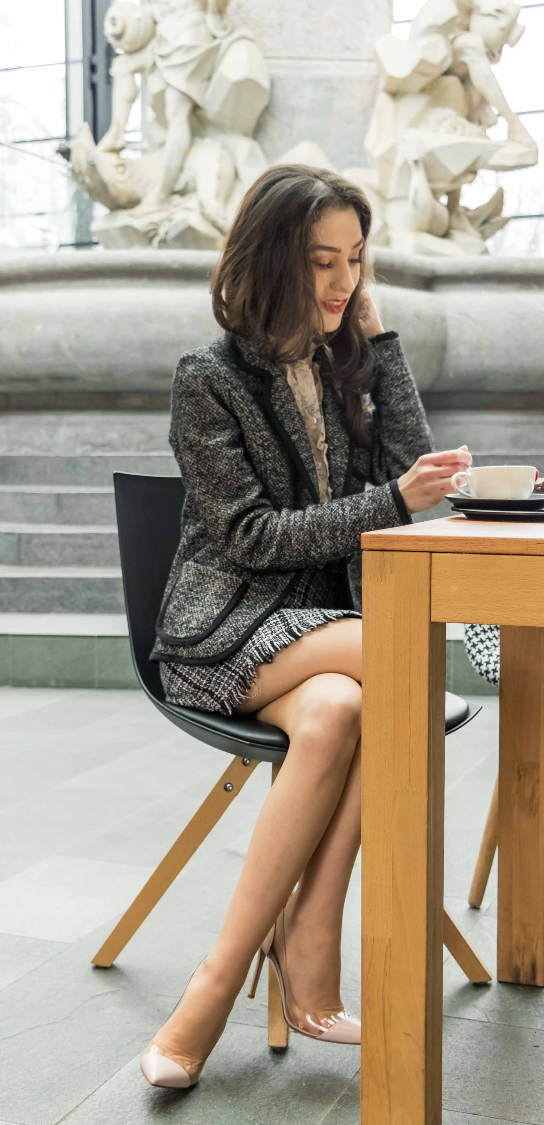 Fashion Blogger Veronika Lipar of Brunette from Wall Street dressed in tweed plaid mini skirt from Storets, black and white Marella tweed jacket, blush Gianvito Rossi Plexi 100 leather and PVC pumps, while drinking tea