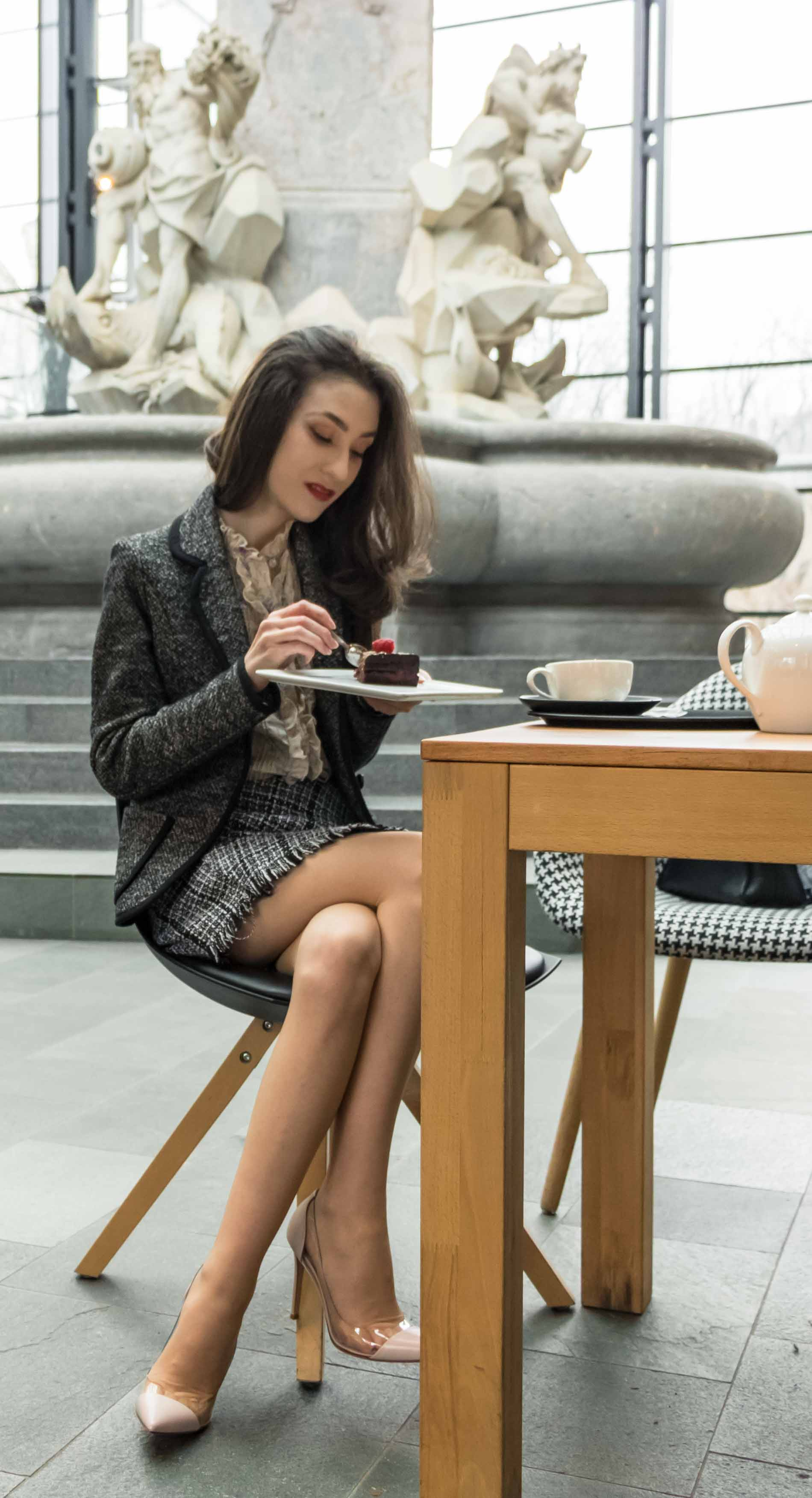 Fashion Blogger Veronika Lipar of Brunette from Wall Street wearing blush Gianvito Rossi Plexi 100 leather and PVC pump shoes, tweed plaid mini skirt from Storets, black and white Marella tweed jacket while having eating a cake