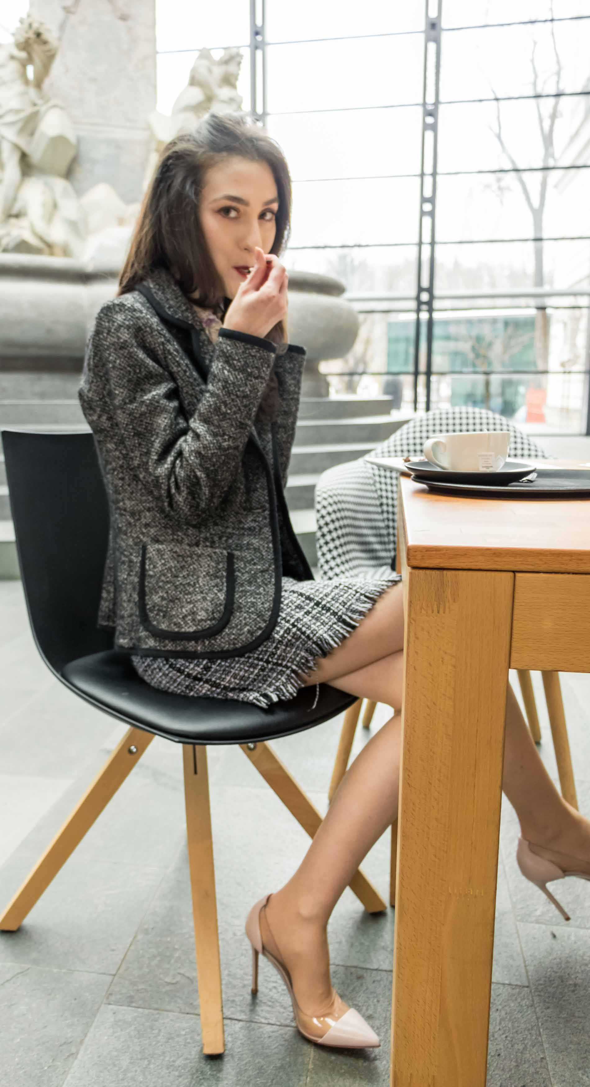 Fashion Blogger Veronika Lipar of Brunette from Wall Street wearing blush Gianvito Rossi Plexi 100 leather and PVC pump shoes, tweed plaid mini skirt from Storets, black and white Marella tweed jacket while eating a cake