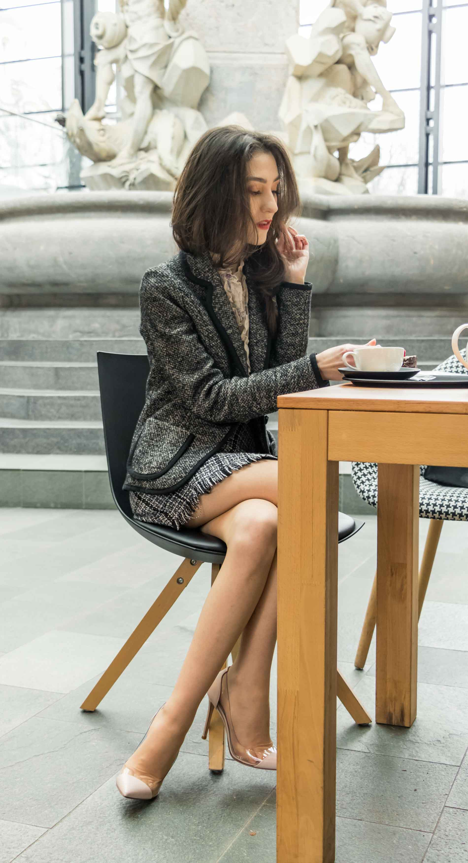 Fashion Blogger Veronika Lipar of Brunette from Wall Street wearing blush Gianvito Rossi Plexi 100 leather and PVC pump shoes, tweed plaid mini skirt from Storets, black and white Marella tweed jacket while drinking coffee