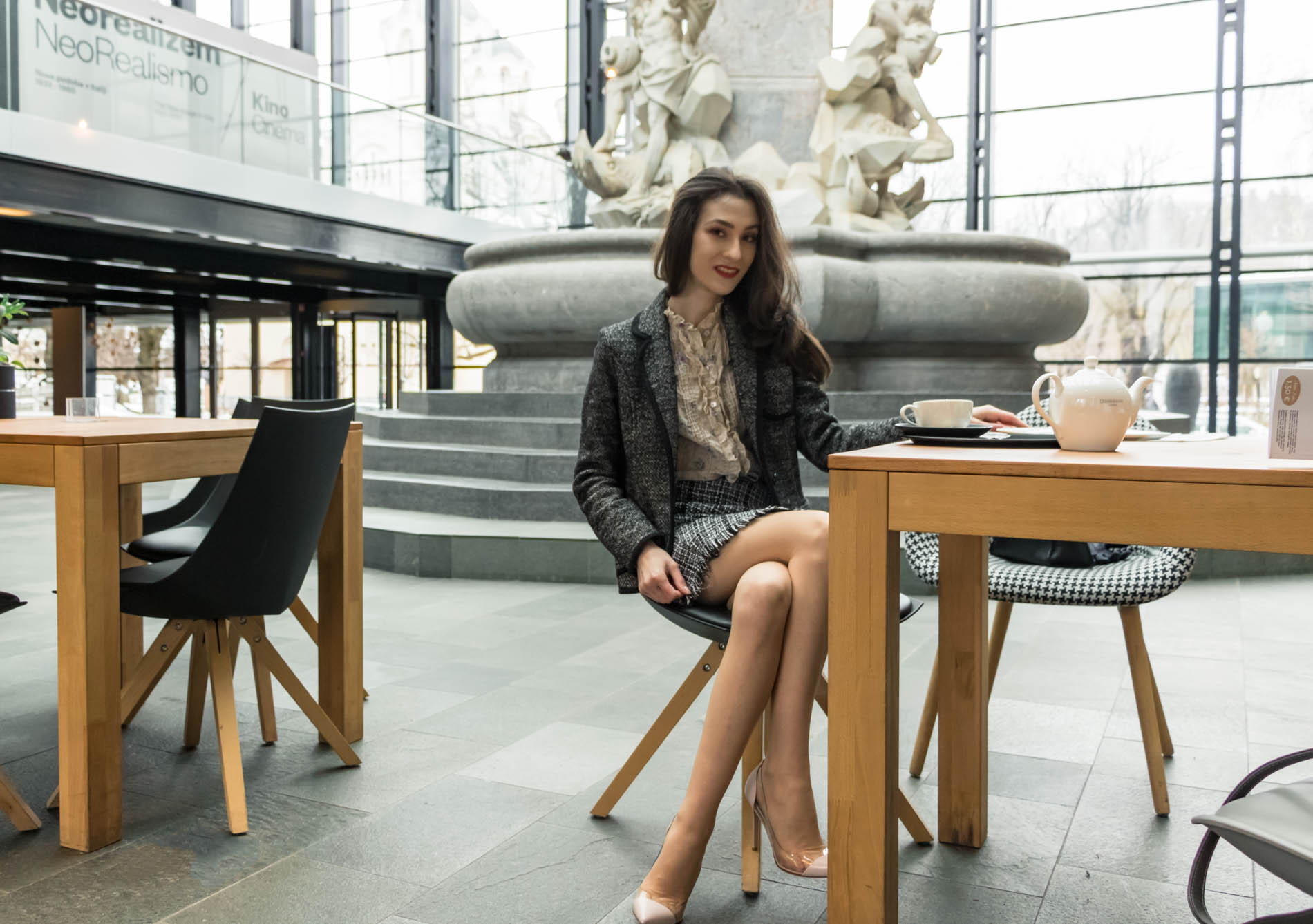 Fashion Blogger Veronika Lipar of Brunette from Wall Street dressed in tweed plaid mini skirt from Storets, black and white Marella tweed jacket, blush Gianvito Rossi Plexi 100 leather and PVC pumps, while having an afternoon tea