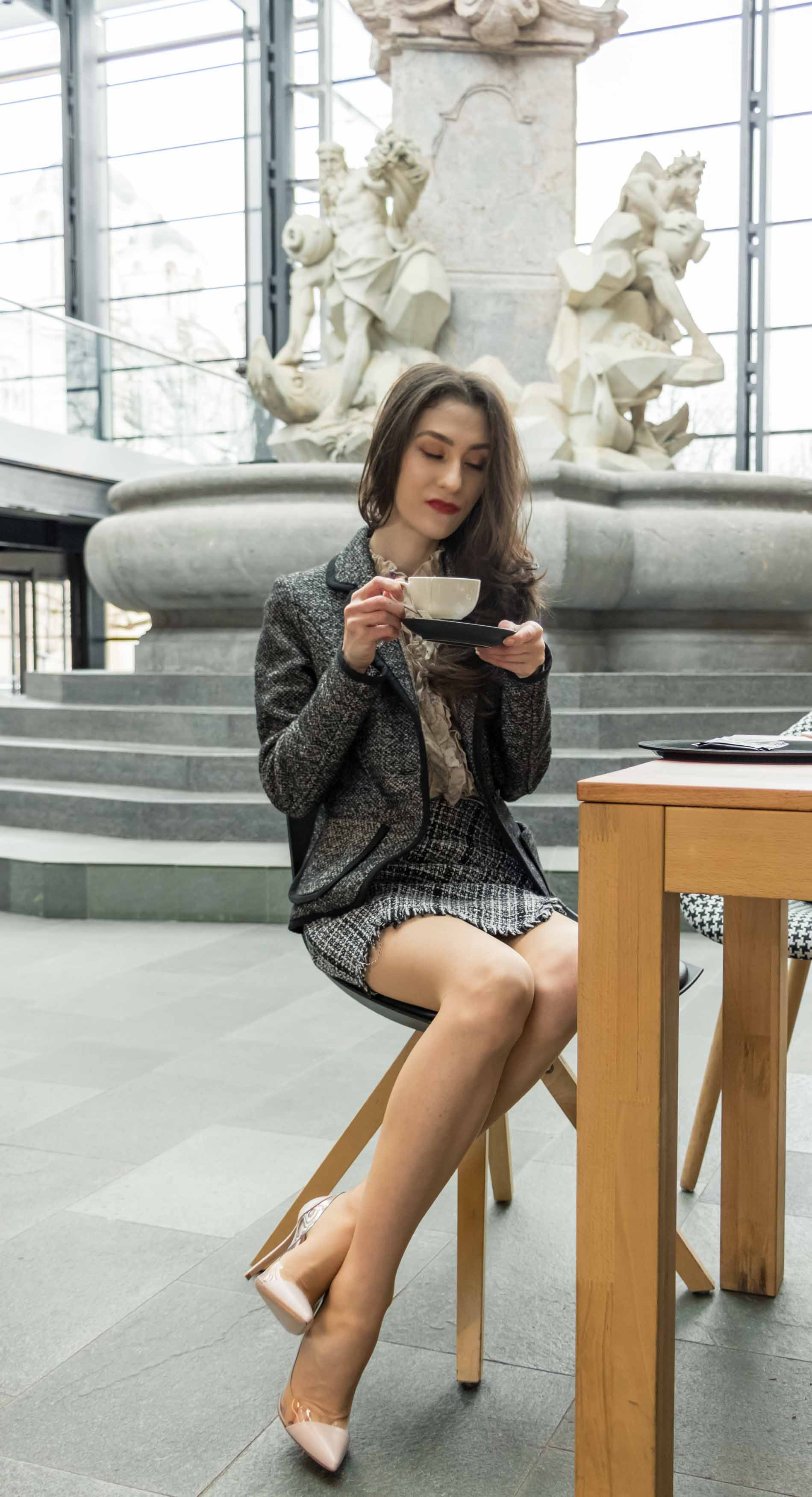 Fashion Blogger Veronika Lipar of Brunette from Wall Street wearing blush Gianvito Rossi Plexi 100 leather and PVC pumps, tweed plaid mini skirt from Storets, black and white Marella tweed jacket while drinking coffee