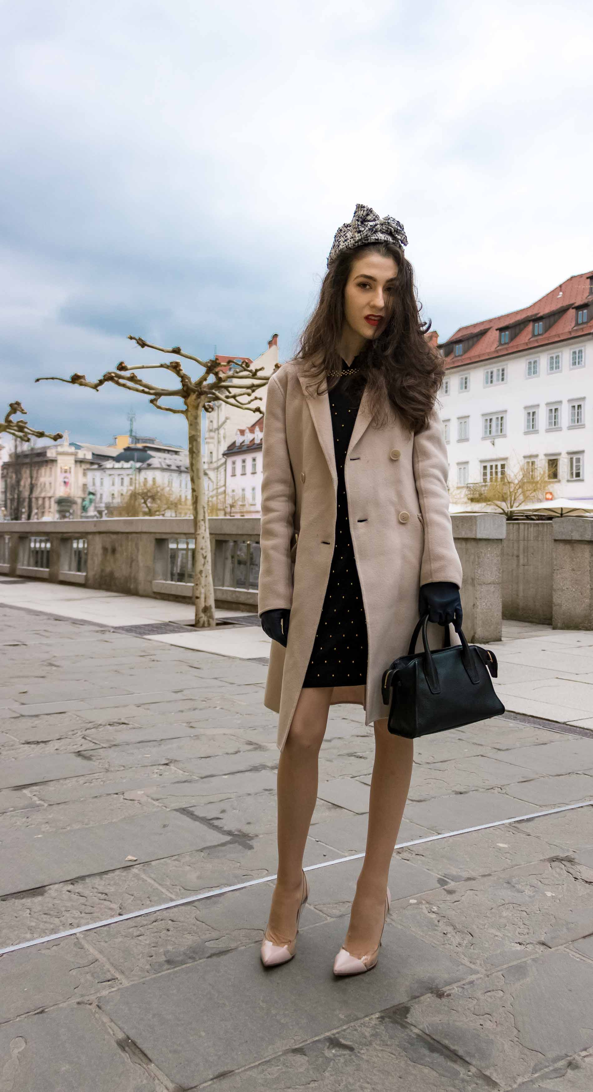 Fashion Blogger Veronika Lipar of Brunette from Wall Street dressed in Weekend Maxmara off-white pastel coat, Gianvito Rossi plexi pumps, small black top handle bag and headwear on the street for Easter holidays before Sunday Mass