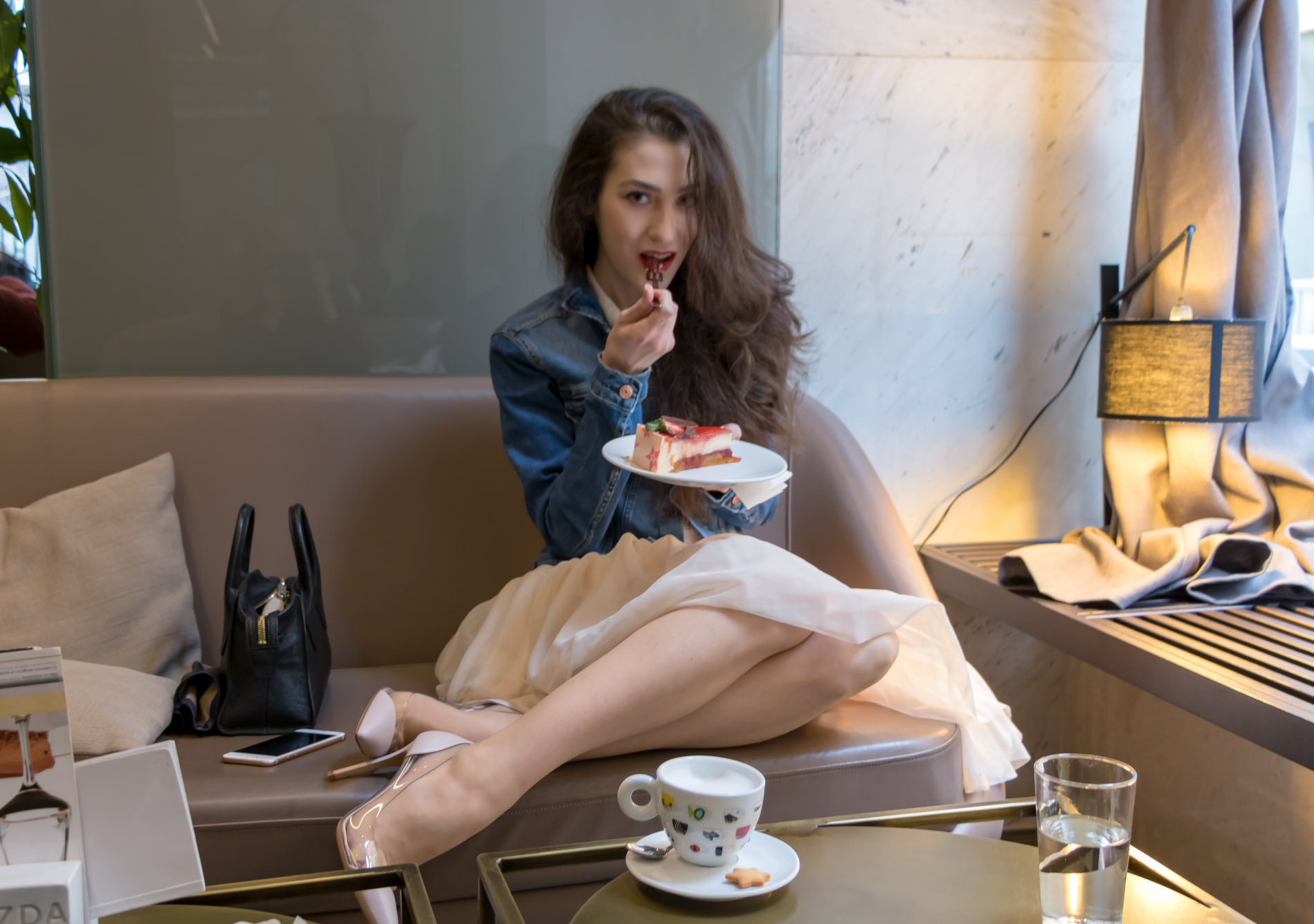 Fashion Blogger Veronika Lipar of Brunette from Wall Street dressed in blush Gianvito Rossi Plexi 100 leather and PVC pump shoes, blush tulle skirt from Zara, blue denim jacket from H&M while eating cake