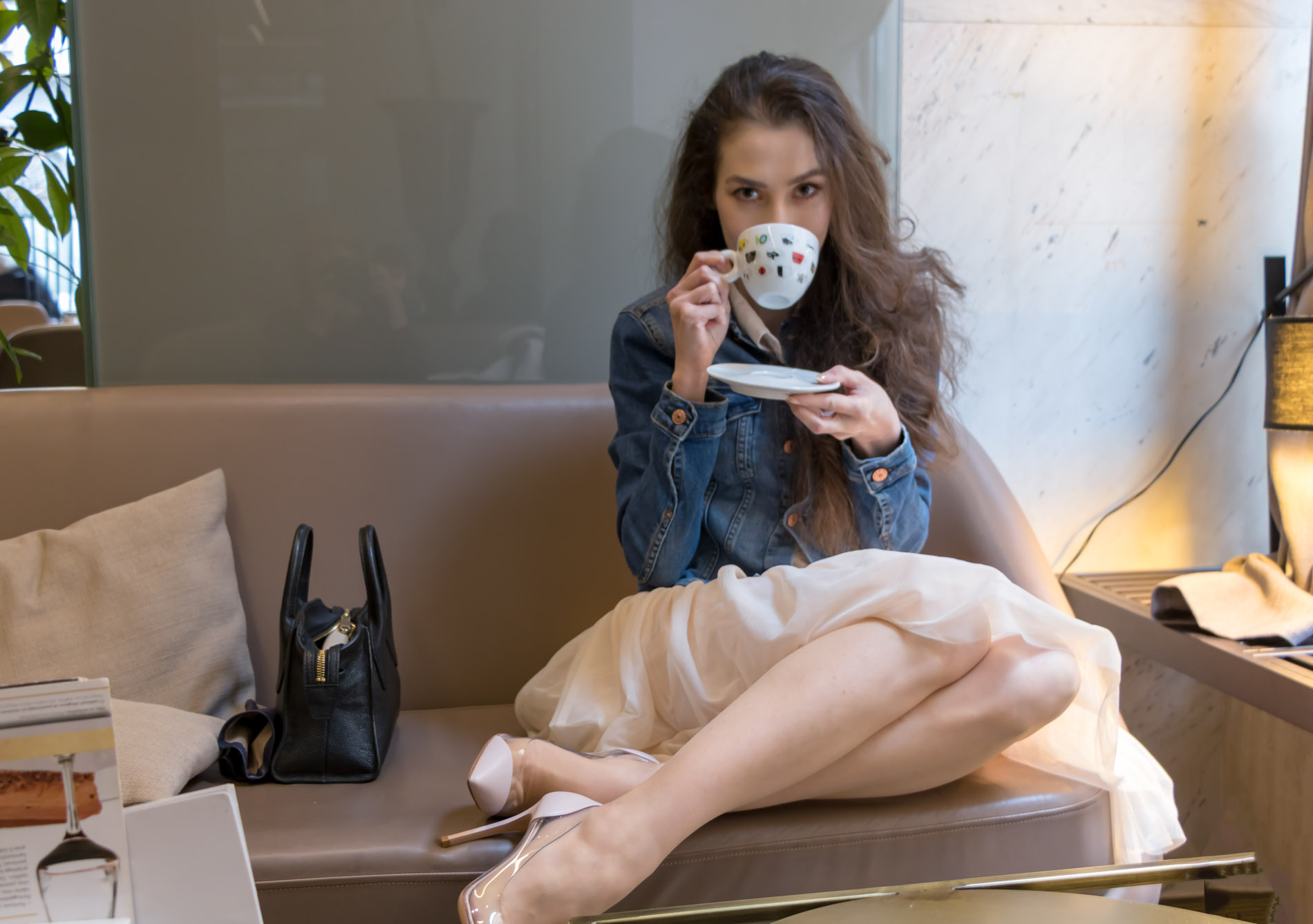 Fashion Blogger Veronika Lipar of Brunette from Wall Street dressed in blush Gianvito Rossi Plexi 100 leather and PVC pump shoes, blush tulle skirt from Zara, blue denim jacket from H&M while drinking coffee