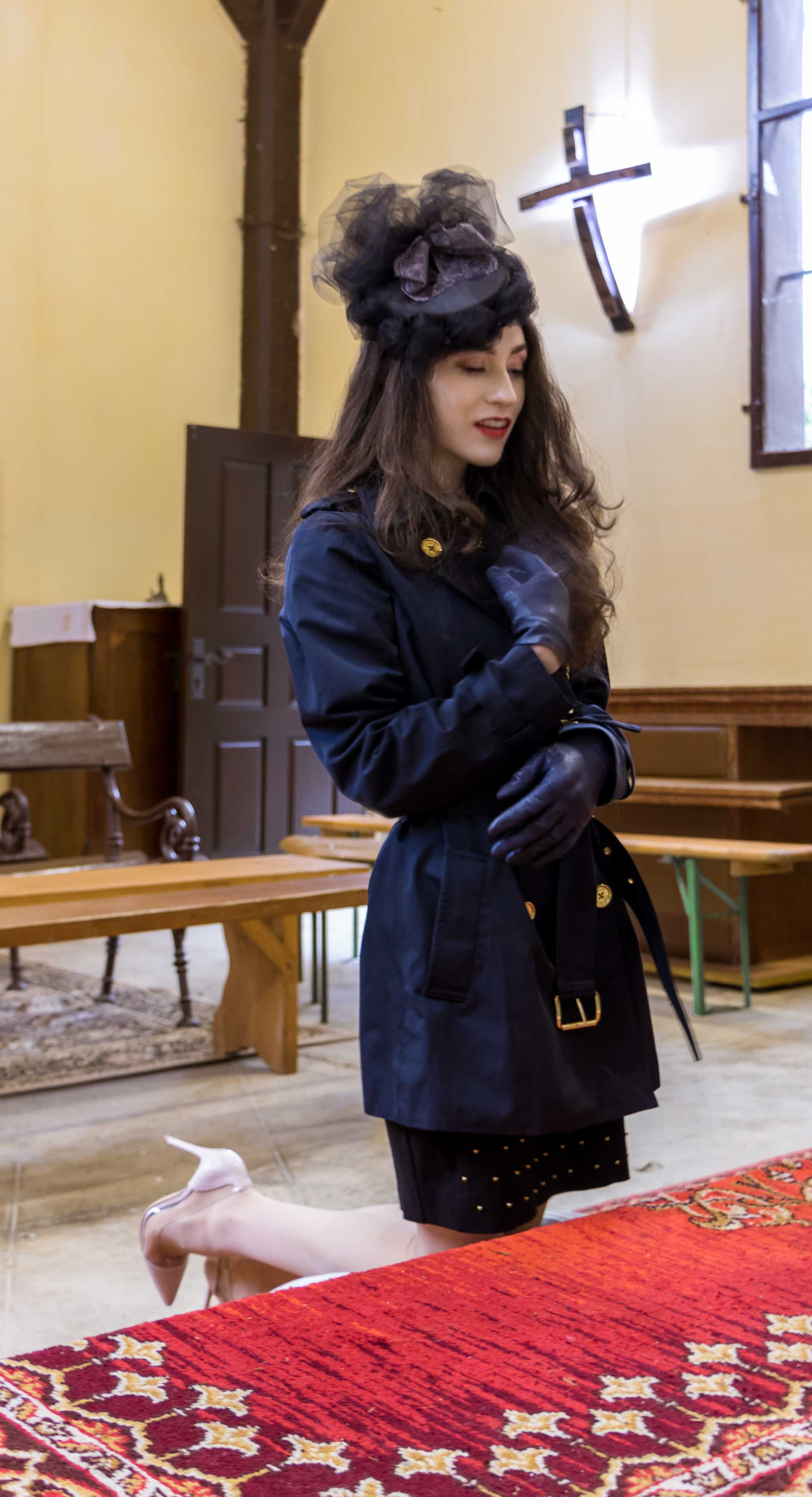 Fashion Blogger Veronika Lipar of Brunette from Wall Street dressed in blue Burberry trench coat, Gianvito Rossi plexi pumps, small black white shoulder bagand headwear in church