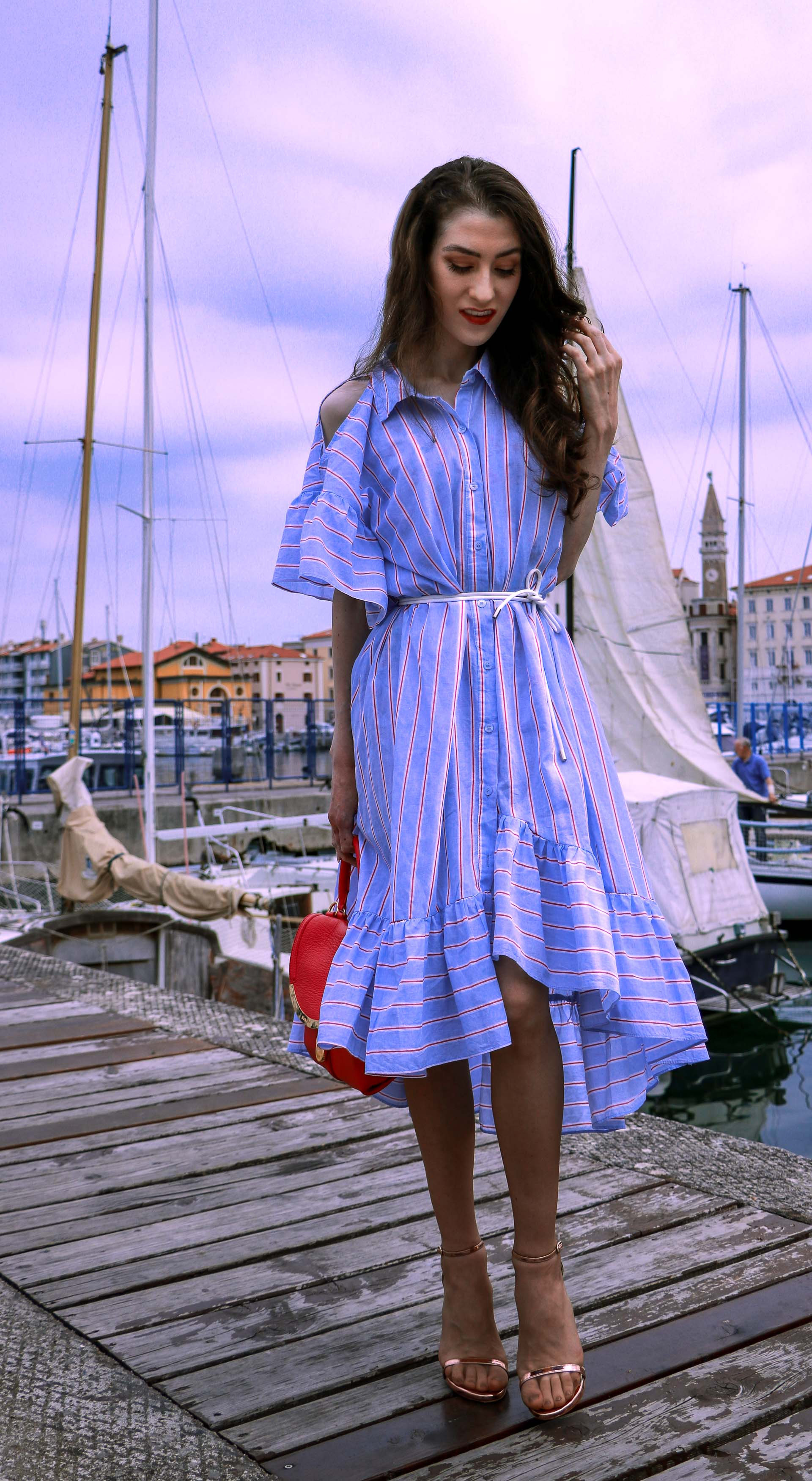 Beautiful Slovenian fashion blogger Veronika Lipar of Brunette from Wall Street dressed in striped cold shoulder shirt dress with rope belt Stuart Weitzman nudist song sandals pink See by Chloe top handle bag on vacation