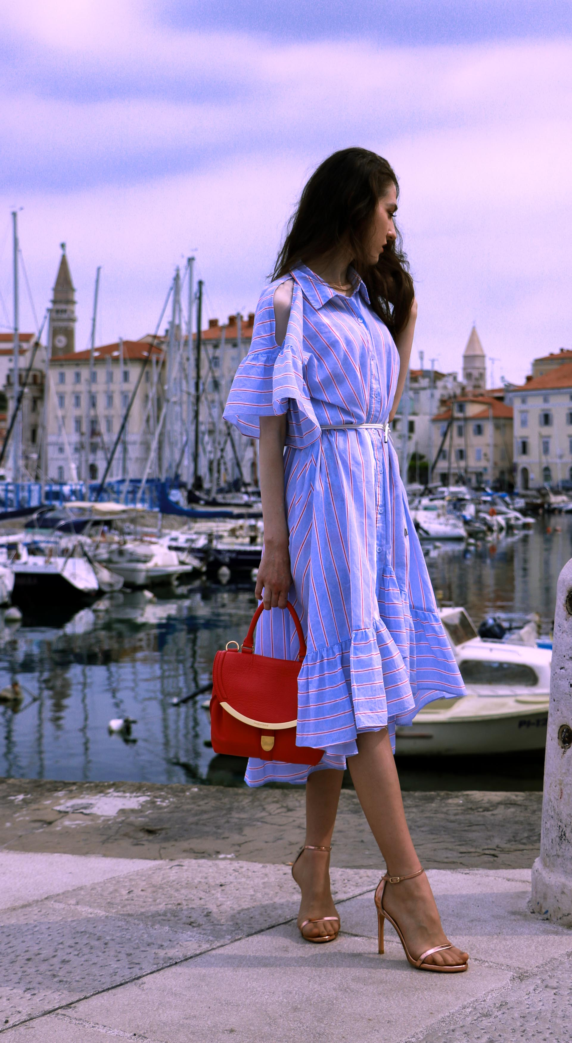Beautiful Slovenian fashion blogger Veronika Lipar of Brunette from Wall Street wearing striped cold shoulder shirt dress with rope belt Stuart Weitzman nudist song sandals pink See by Chloe top handle bag in marine