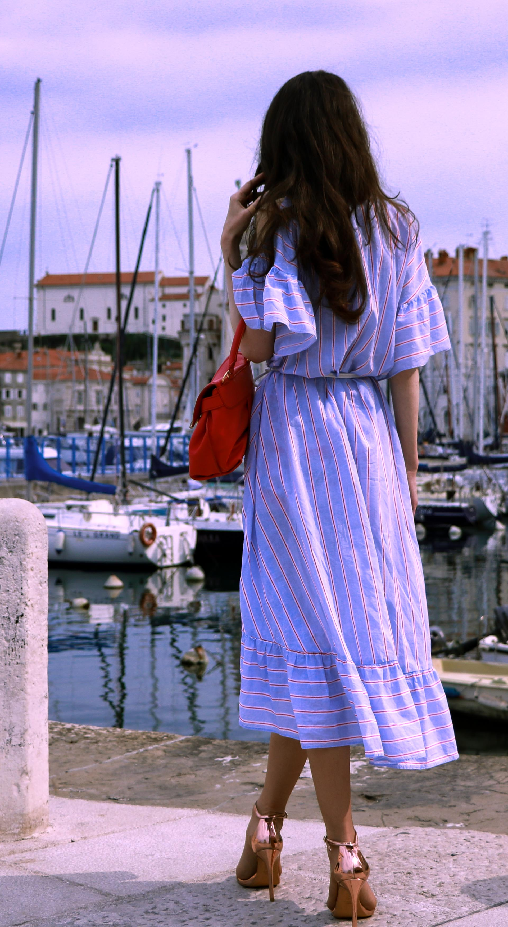 Beautiful Slovenian fashion blogger Veronika Lipar of Brunette from Wall Street wearing striped cold shoulder shirt dress with rope belt Stuart Weitzman nudist song sandals pink See by Chloe top handle bag on vacation