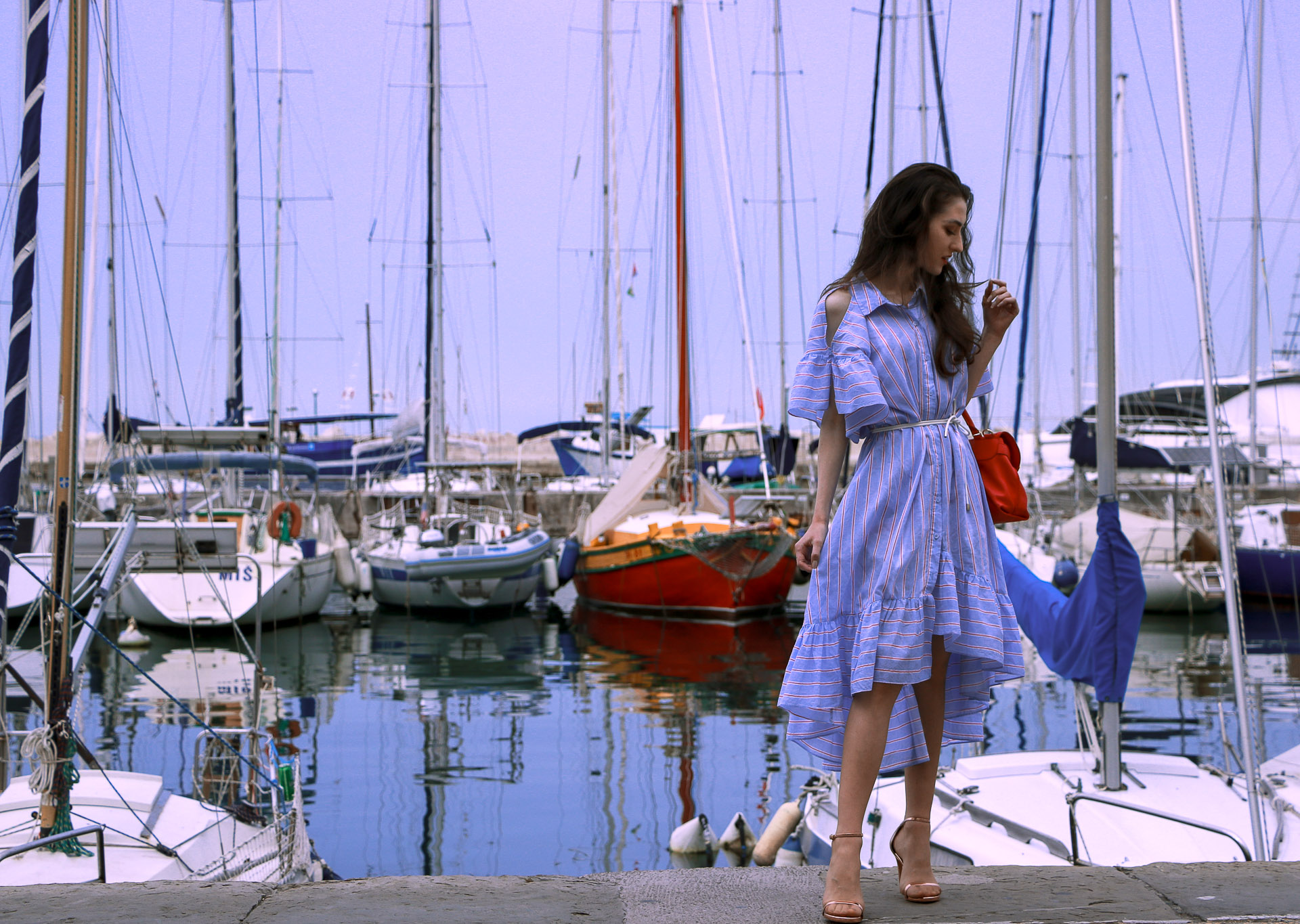 Beautiful Slovenian fashion blogger Veronika Lipar of Brunette from Wall Street dressed in striped cold shoulder shirt dress with rope belt Stuart Weitzman nudist song sandals pink See by Chloe top handle bag in marine