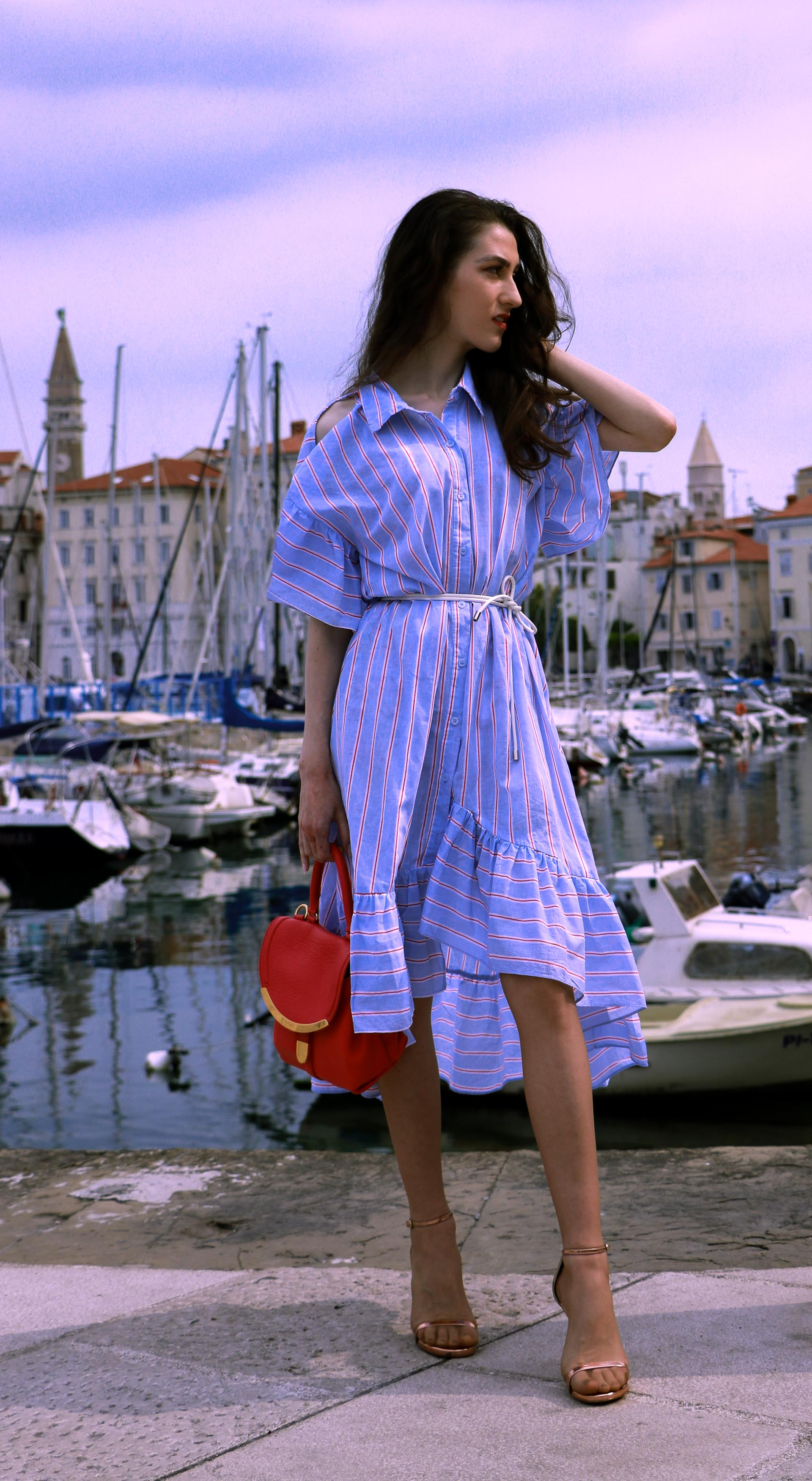 Beautiful Slovenian fashion blogger Veronika Lipar of Brunette from Wall Street wearing striped cold shoulder shirt dress with rope belt Stuart Weitzman nudist song sandals pink See by Chloe top handle bag in port