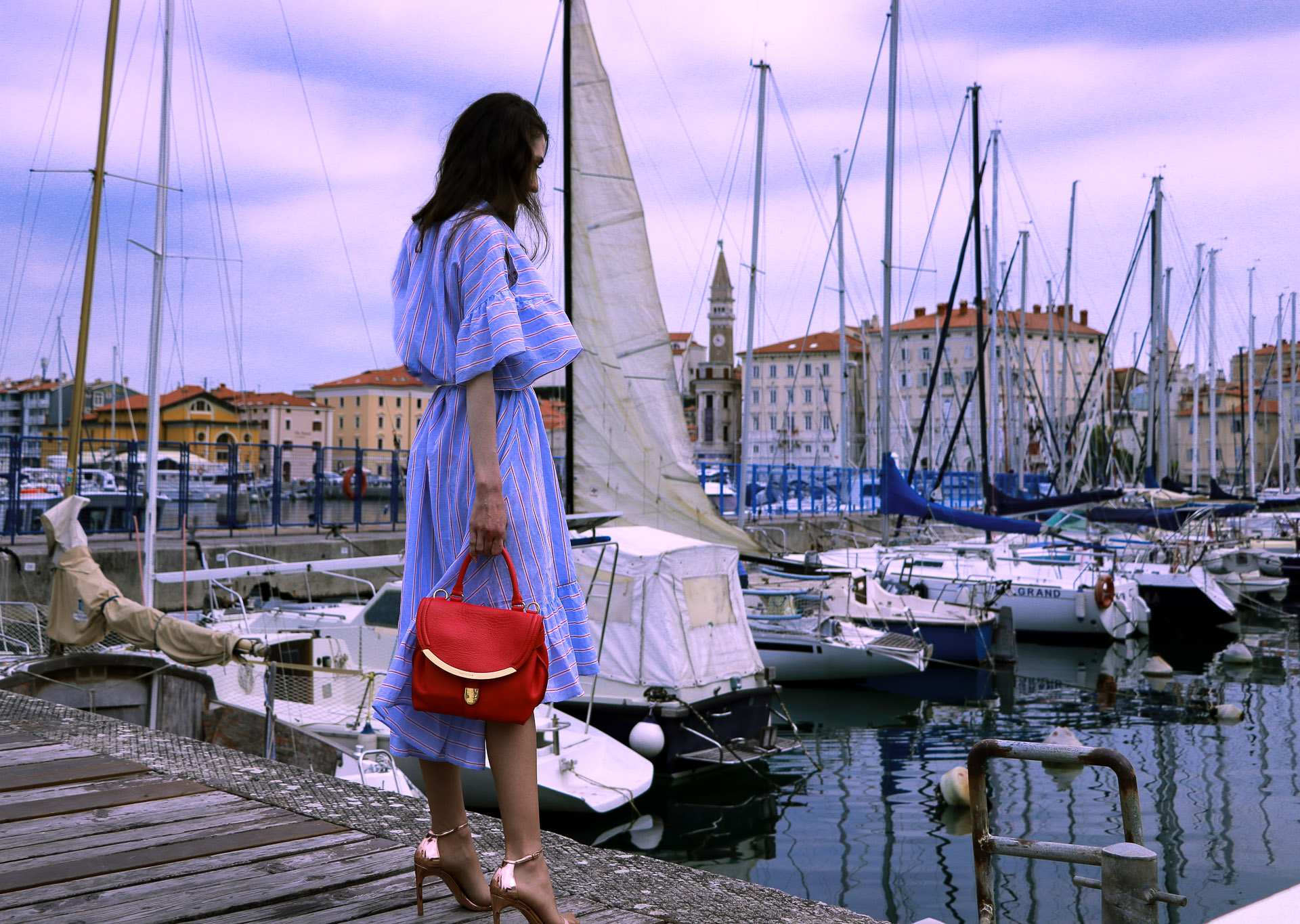 Beautiful Slovenian fashion blogger Veronika Lipar of Brunette from Wall Street dressed in striped cold shoulder shirt dress with rope belt Stuart Weitzman nudist song sandals pink See by Chloe top handle bag on holidays