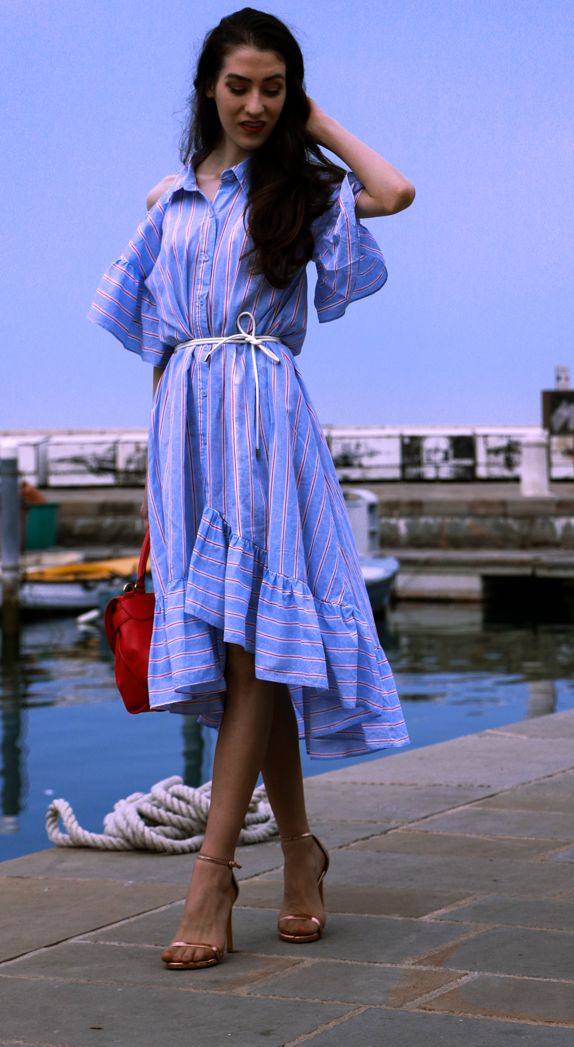 Beautiful Slovenian fashion blogger Veronika Lipar of Brunette from Wall Street dressed in striped cold shoulder shirt dress with rope belt Stuart Weitzman nudist song sandals pink See by Chloe top handle bag