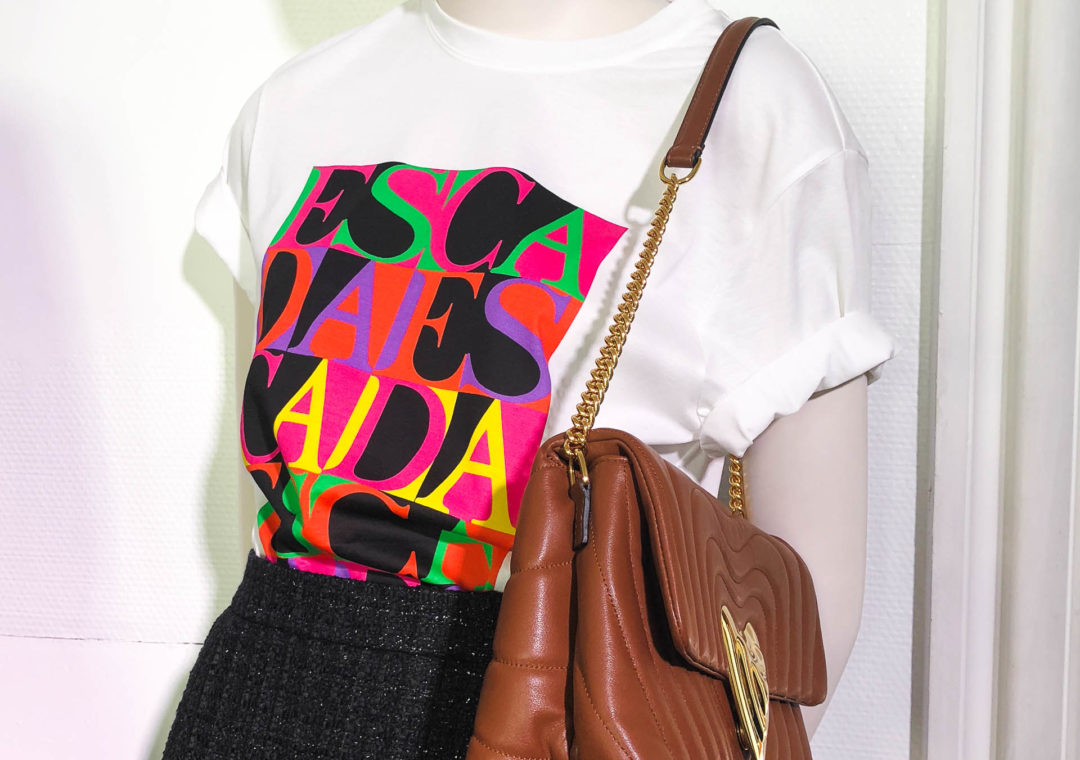 Brunette from Wall Street Escada 80s print logo t-shirt shoulder bag