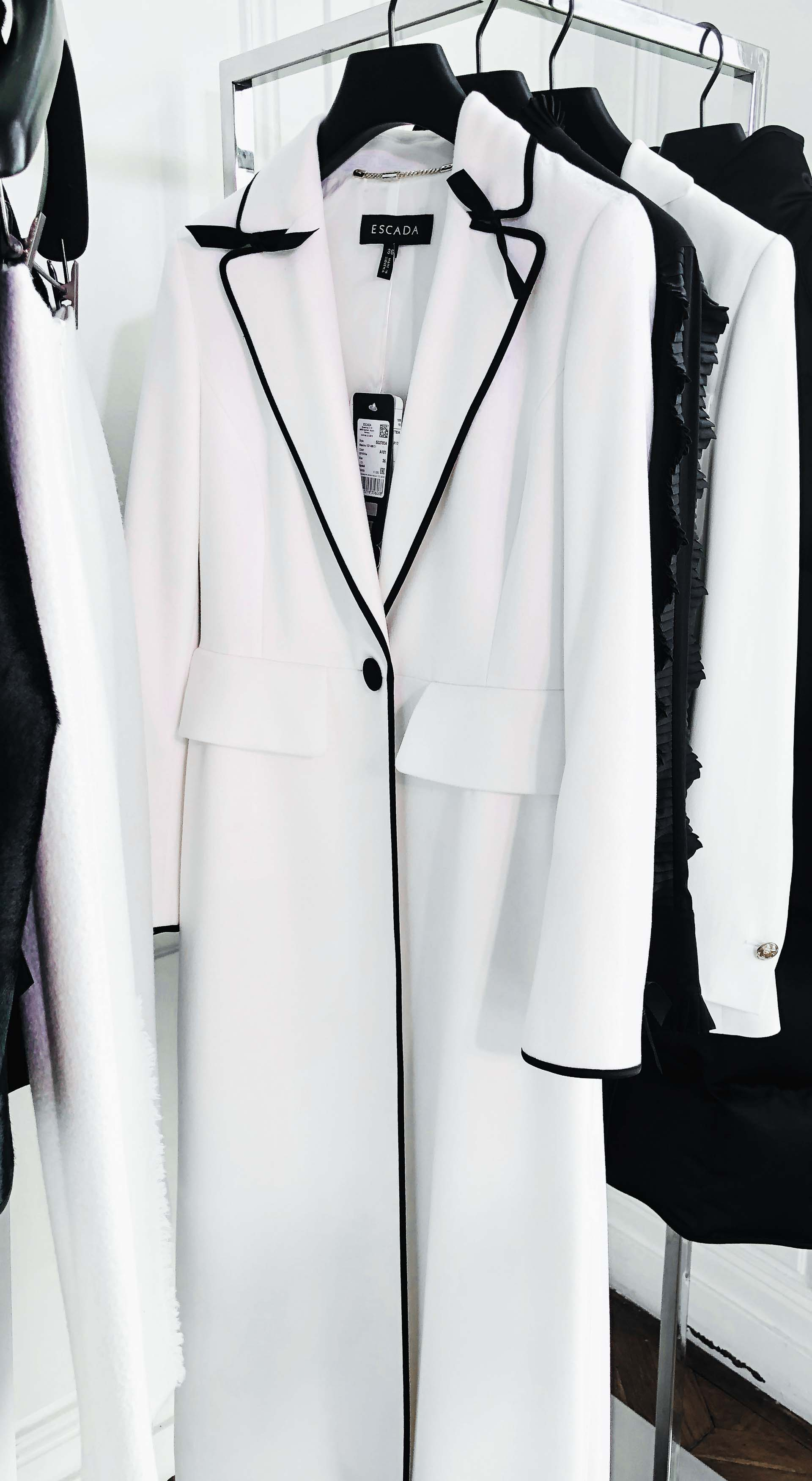 Brunette from Wall Street Escada black and white coat