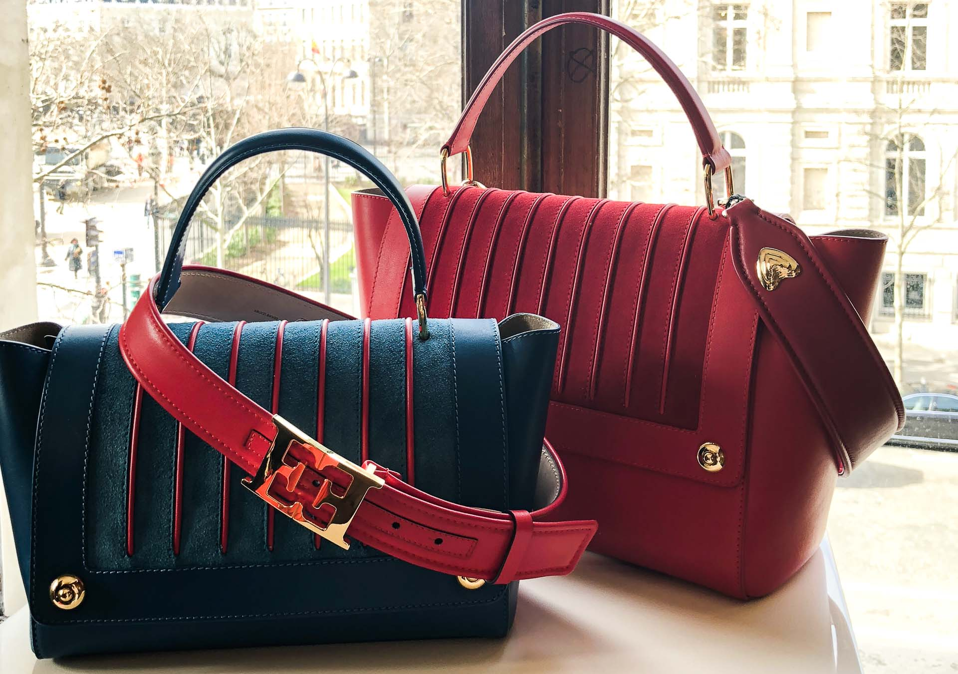 Brunette from Wall Street Escada blue and red bags and belt