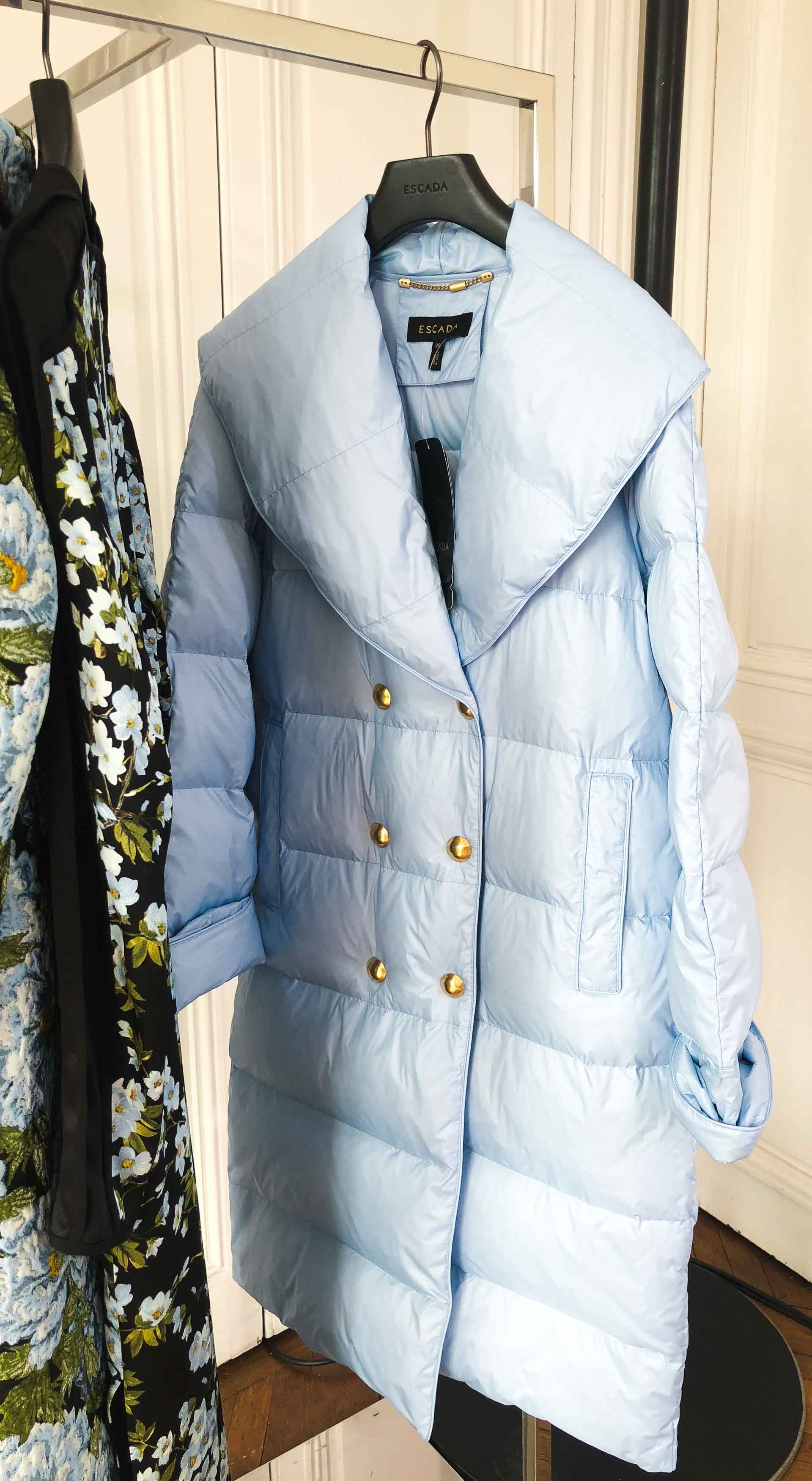 Brunette from Wall Street Escada blue puffer coat