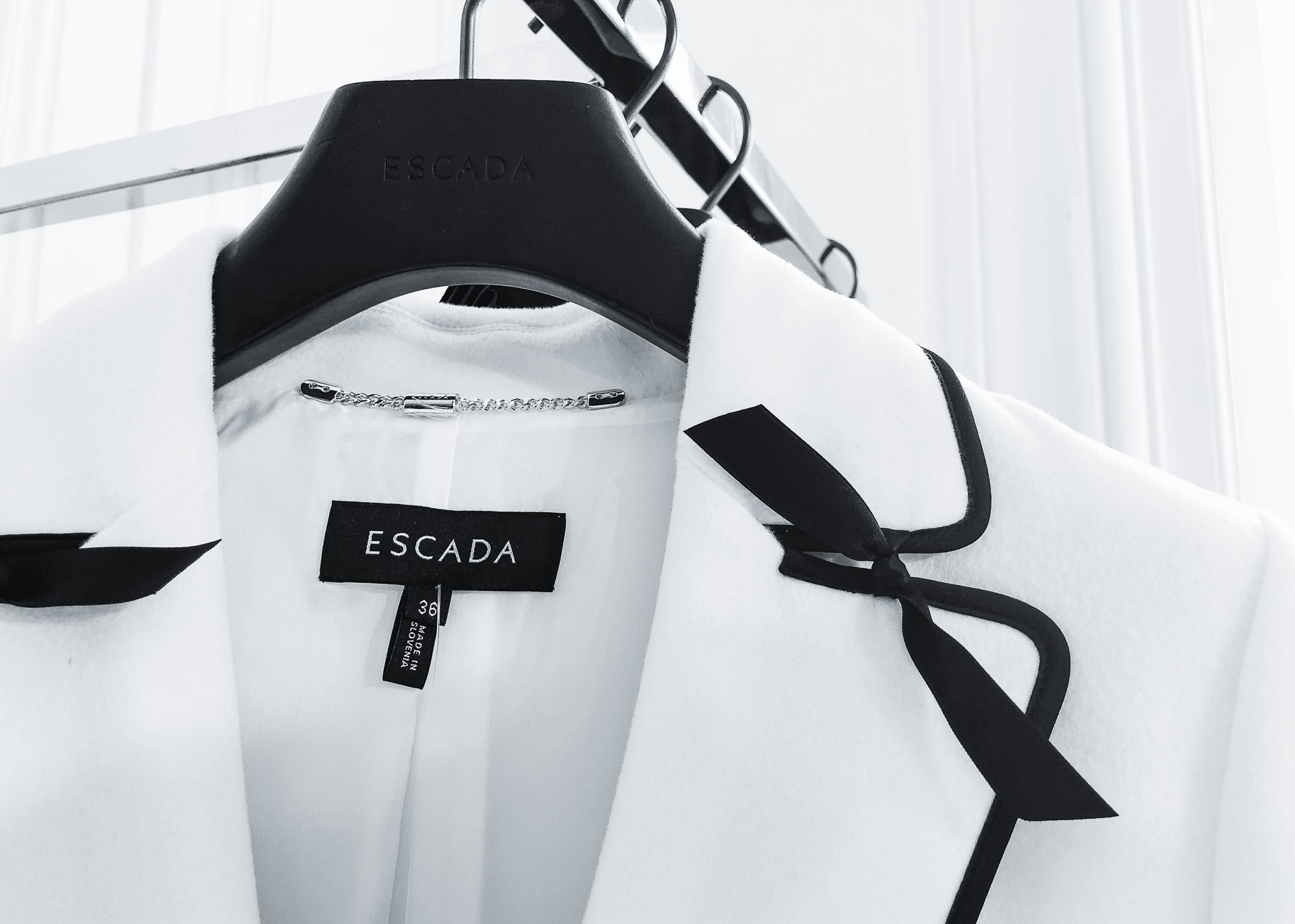 Brunette from Wall Street Escada bow details