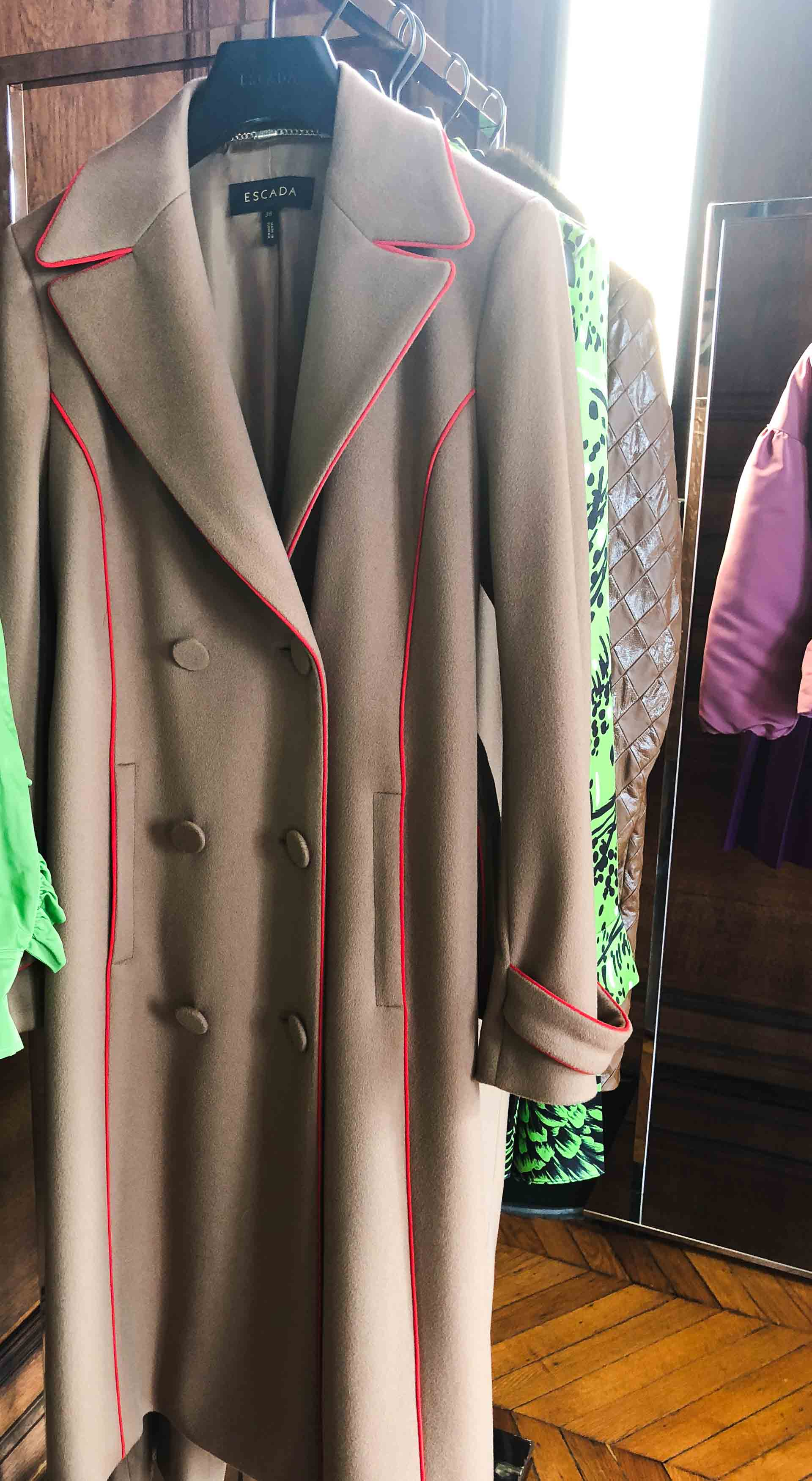 Brunette from Wall Street Escada camel double breasted coat