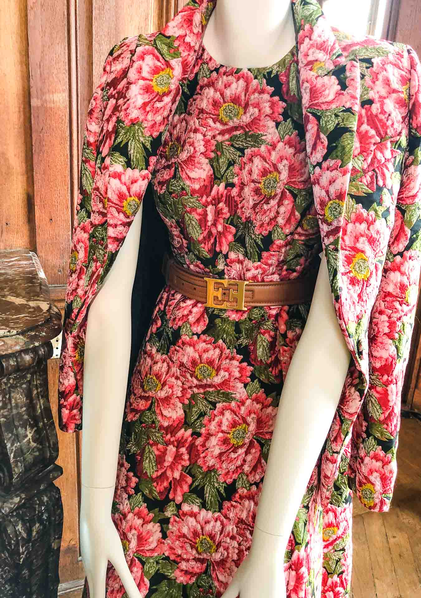 Brunette from Wall Street Escada floral dress with brown belt