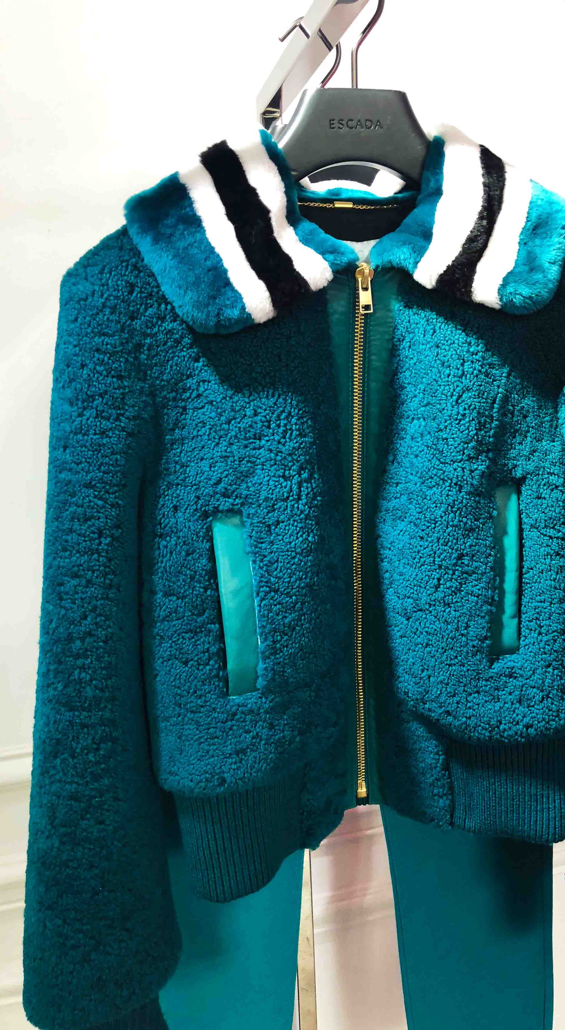 Brunette from Wall Street Escada green blue shearling jacket