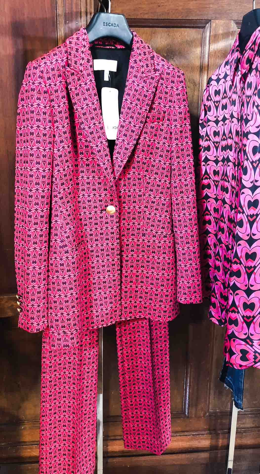 Brunette from Wall Street Escada heart print suit