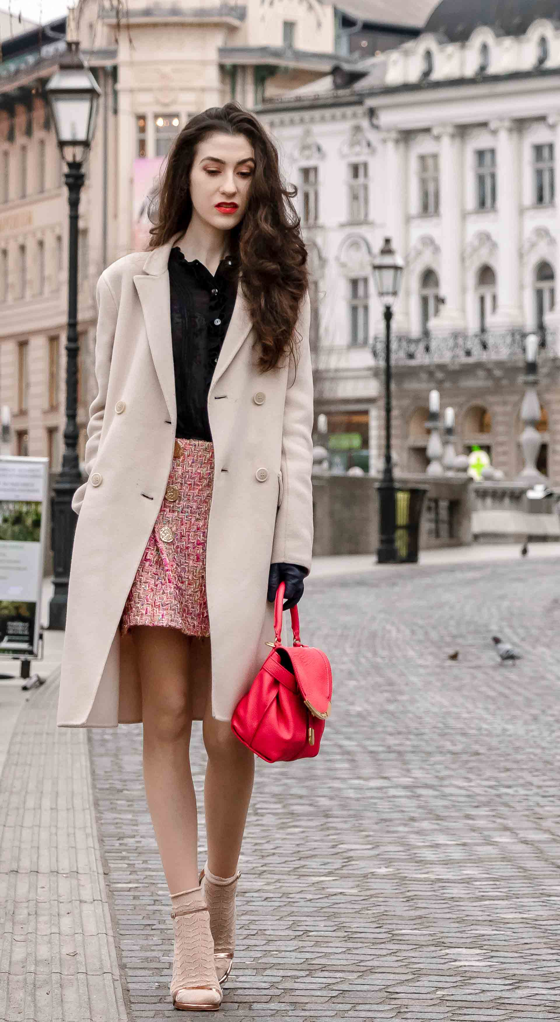 Fashion Blogger Veronika Lipar of Brunette from Wall Street wearing bronze socks and high shine rose gold Songnudist sandals from Stuart Weitzman, tweed Storets minis skirt, black blouse, off white Weekend Maxmara coat while walking down the street in Ljubljana