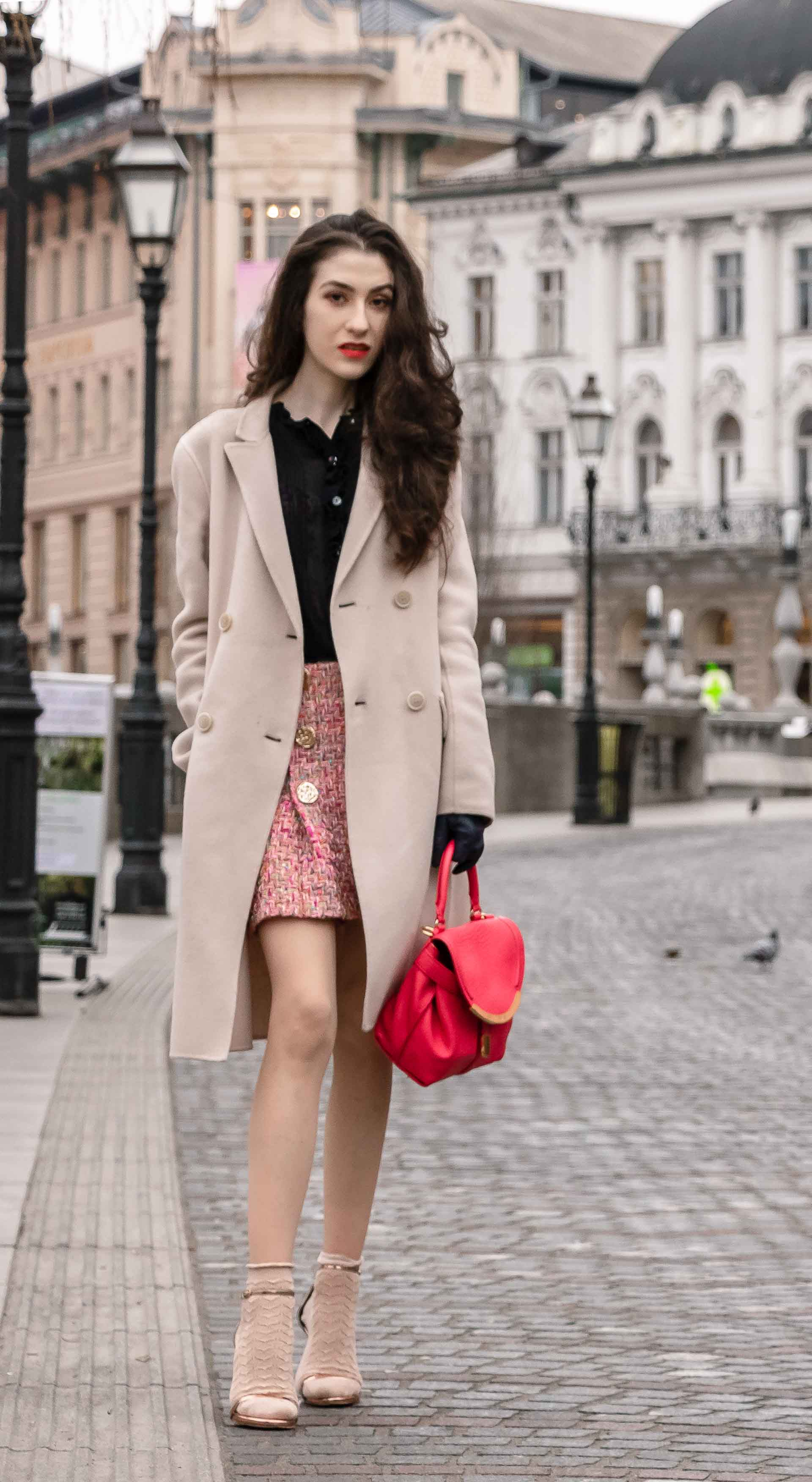Fashion Blogger Veronika Lipar of Brunette from Wall Street wearing bronze socks and sandals from Stuart Weitzman, tweed Storets minis skirt, black blouse, off white Weekend Maxmara coat while in Ljubljana
