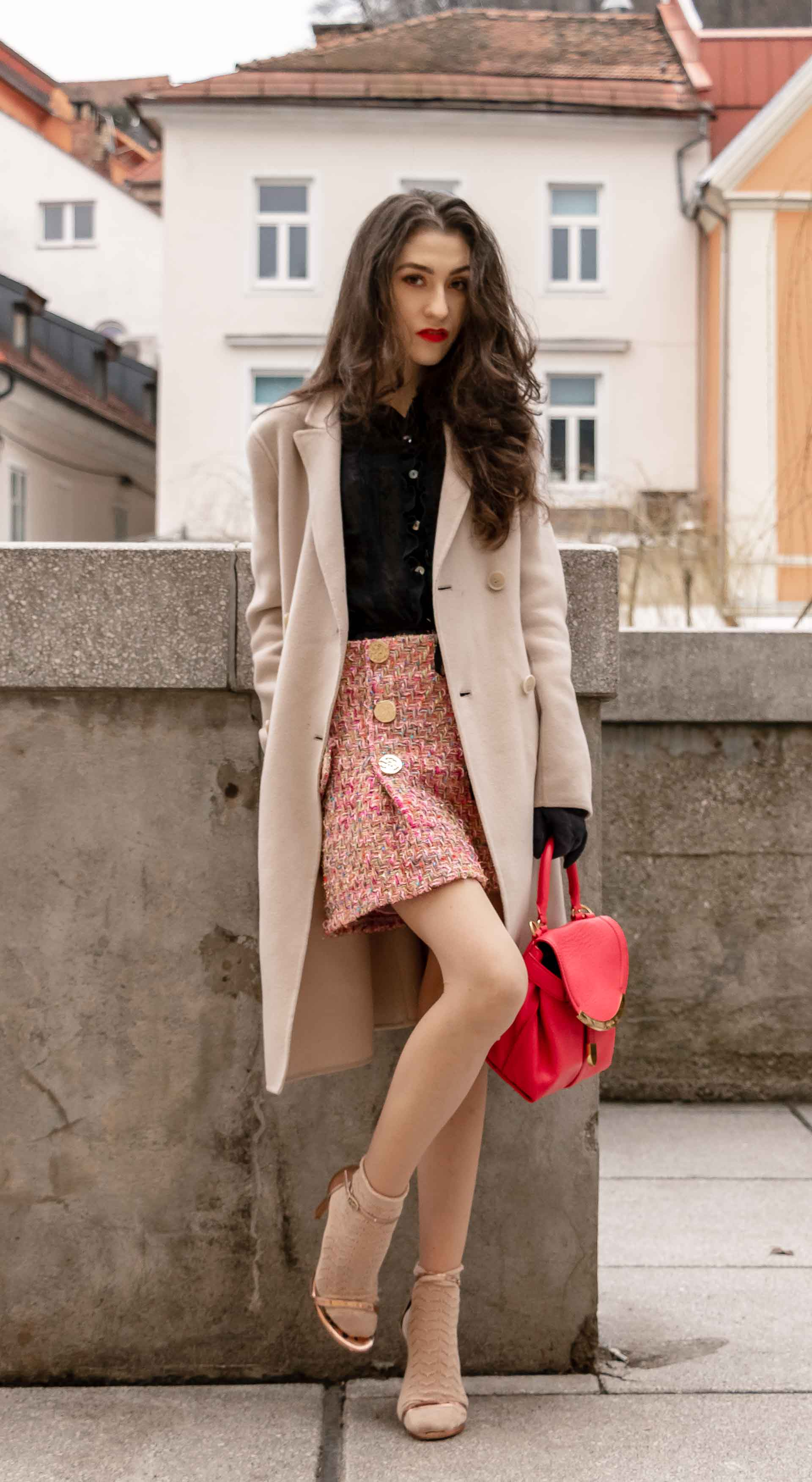 Fashion Blogger Veronika Lipar of Brunette from Wall Street wearing bronze socks and high shine rose gold Songnudist sandals from Stuart Weitzman, tweed Storets minis skirt, black blouse, off white Weekend Maxmara coat in Ljubljana