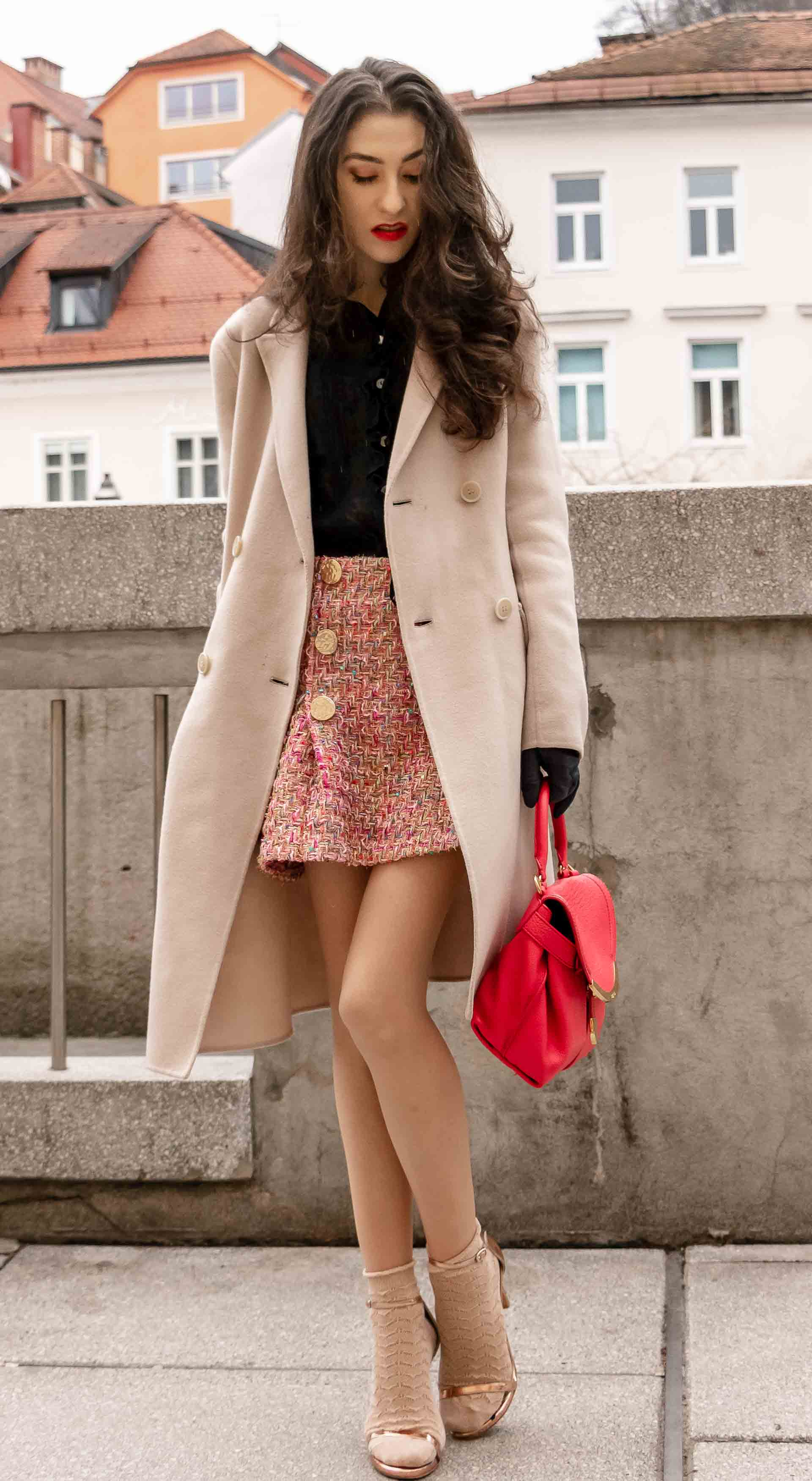 Fashion Blogger Veronika Lipar of Brunette from Wall Street dressed in bronze socks and sandals from Stuart Weitzman, tweed Storets minis skirt, black blouse, off white Weekend Maxmara coat while walking down the street in Ljubljana