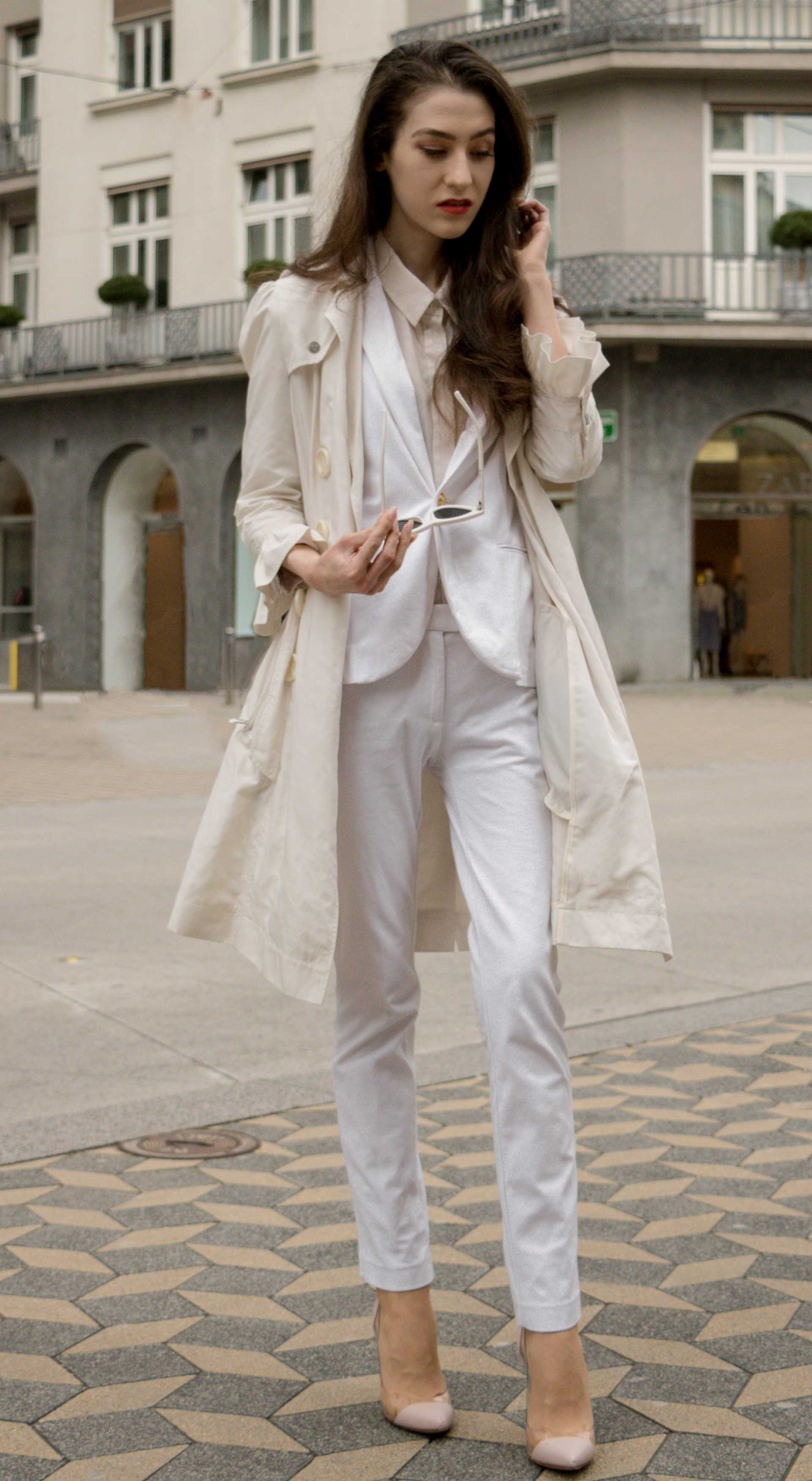 Veronika Lipar Fashion Blogger of Brunette from Wall Street wearing formal business white suit from Juicy Couture, long white trench coat with ruffled sleeves, Adam Selman x Lespecs white lolita sunglasses, blush Gianvito Rossi plexi pumps for work in spring summer