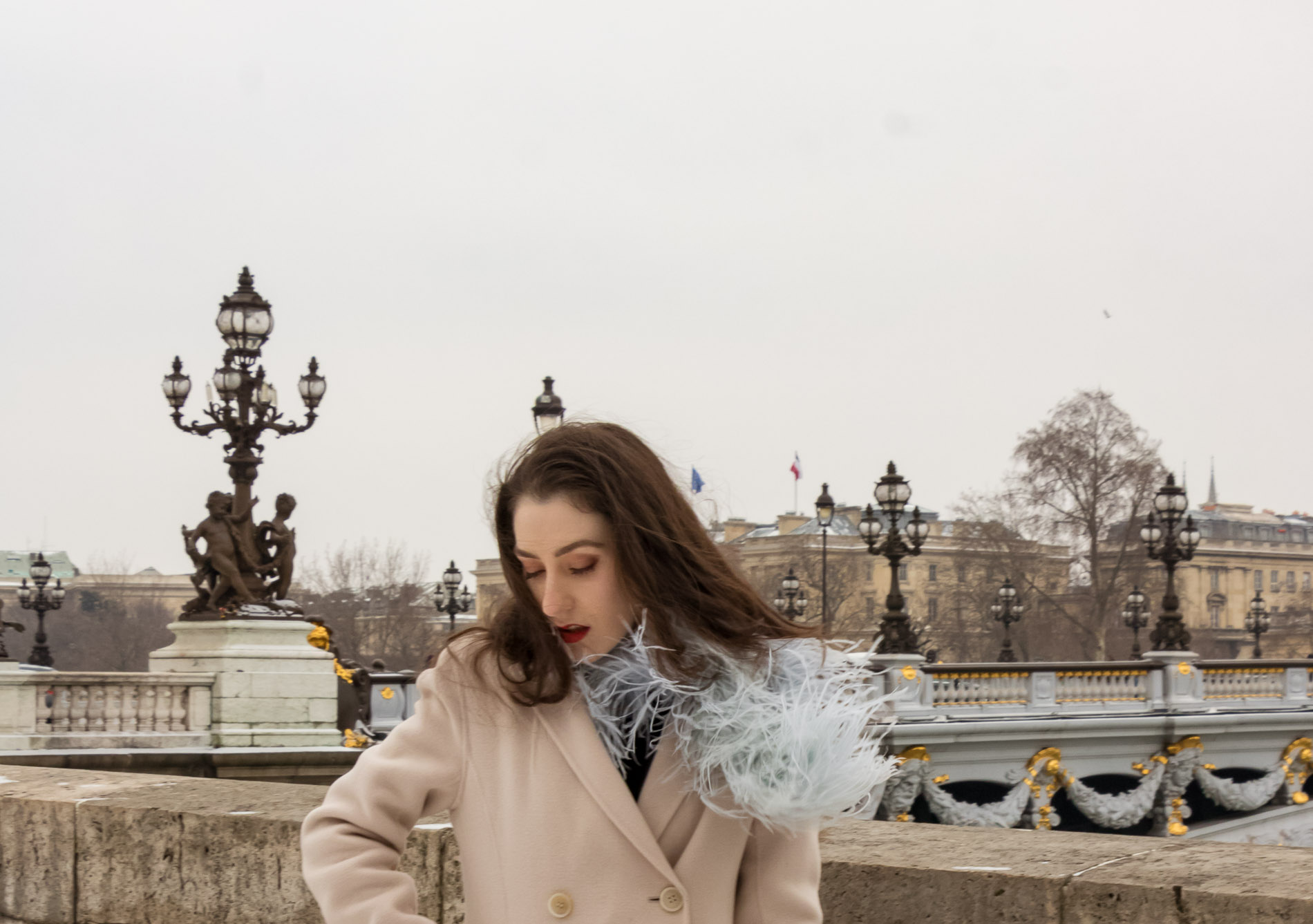 Fashion Blogger Veronika Lipar of Brunette from Wall Street wearing feathers, Weekend Maxmara coat at Paris fashion week autumn winter 2018/19