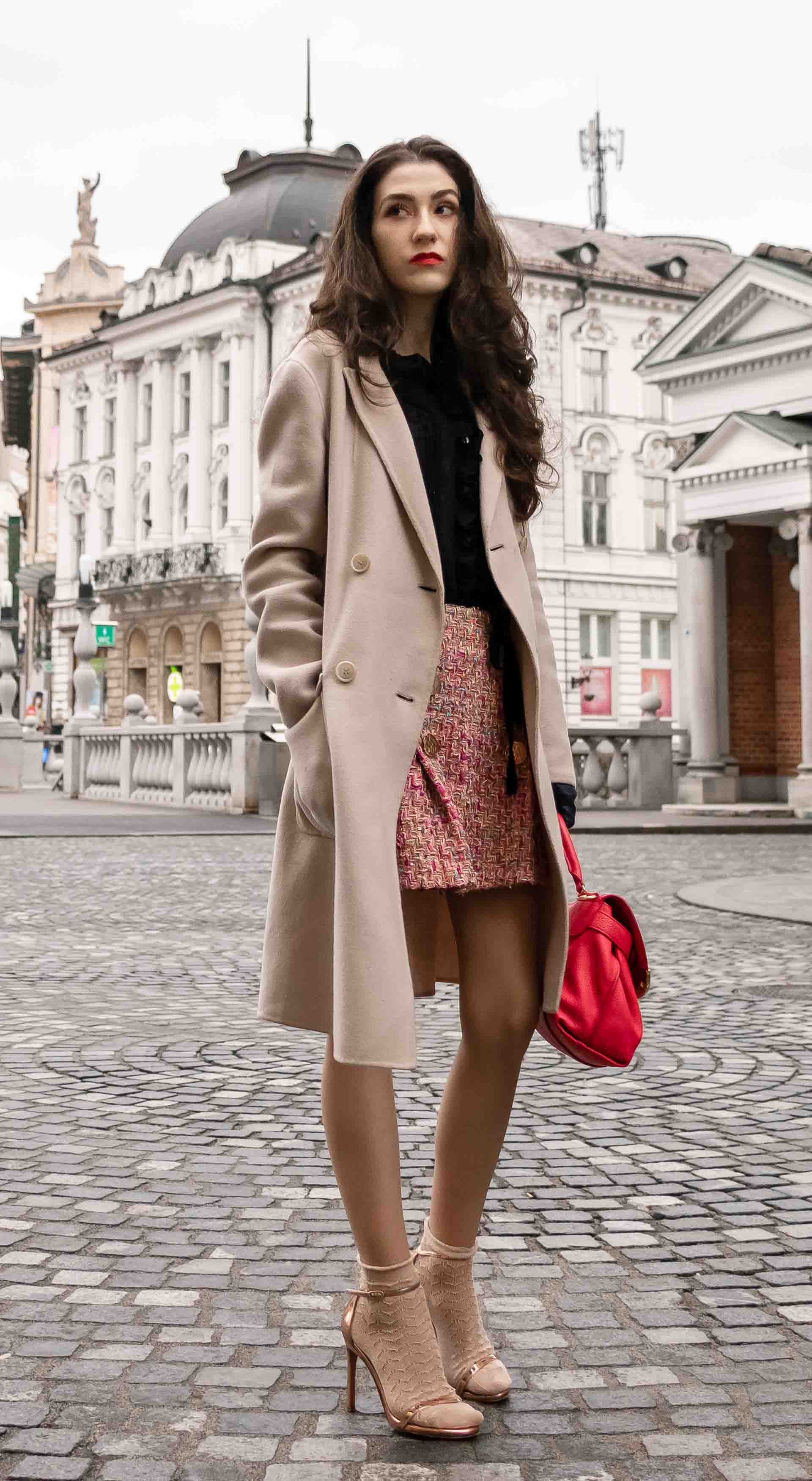 Fashion Blogger Veronika Lipar of Brunette from Wall Street dressed in bronze socks and sandals from Stuart Weitzman, tweed Storets mini skirt, black blouse, off white Weekend Maxmara coat in Ljubljana