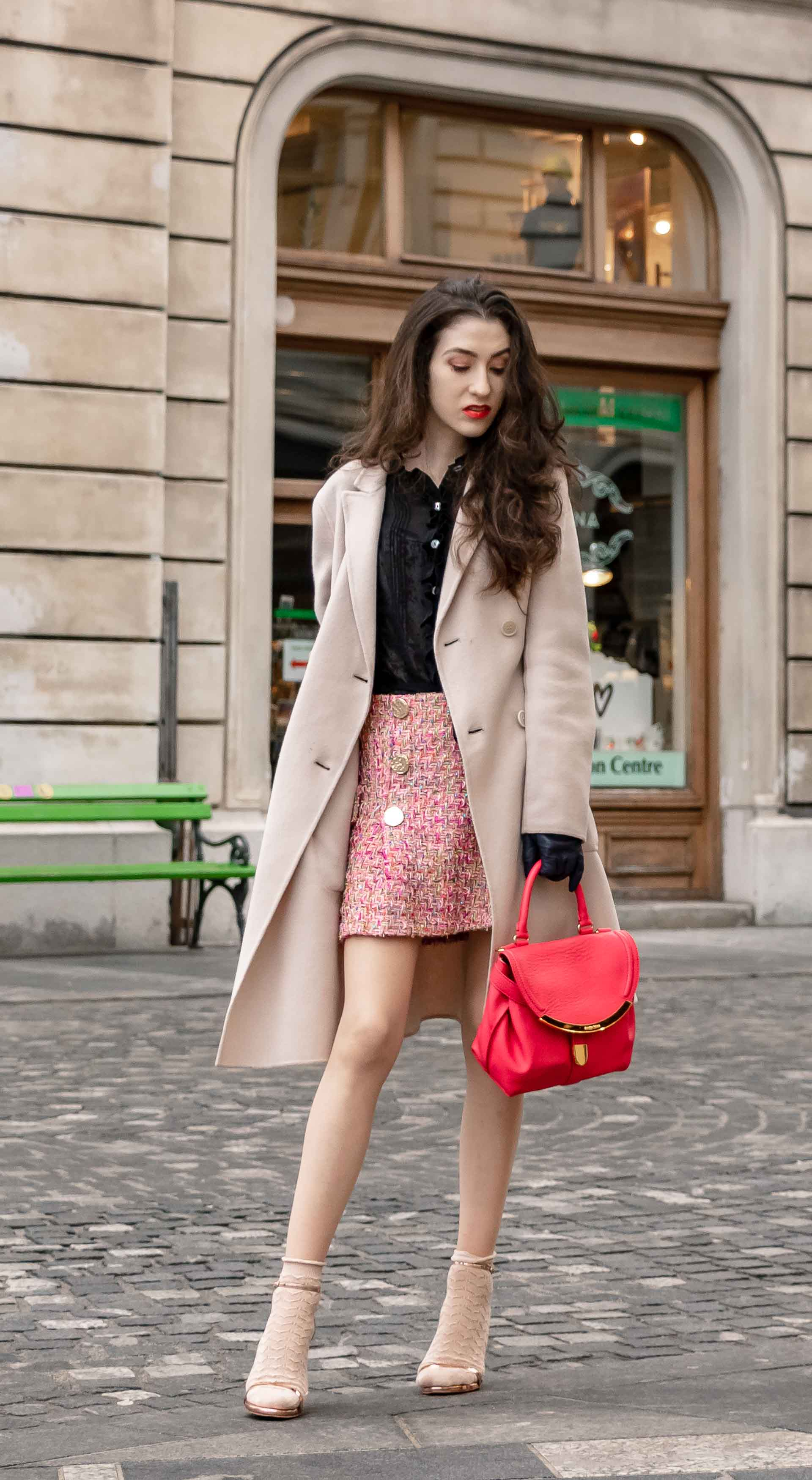 Fashion Blogger Veronika Lipar of Brunette from Wall Street dressed in bronze socks and high shine rose gold Songnudist sandals from Stuart Weitzman, tweed Storets mini skirt, black blouse, off white Weekend Maxmara coat while on the street in Ljubljana
