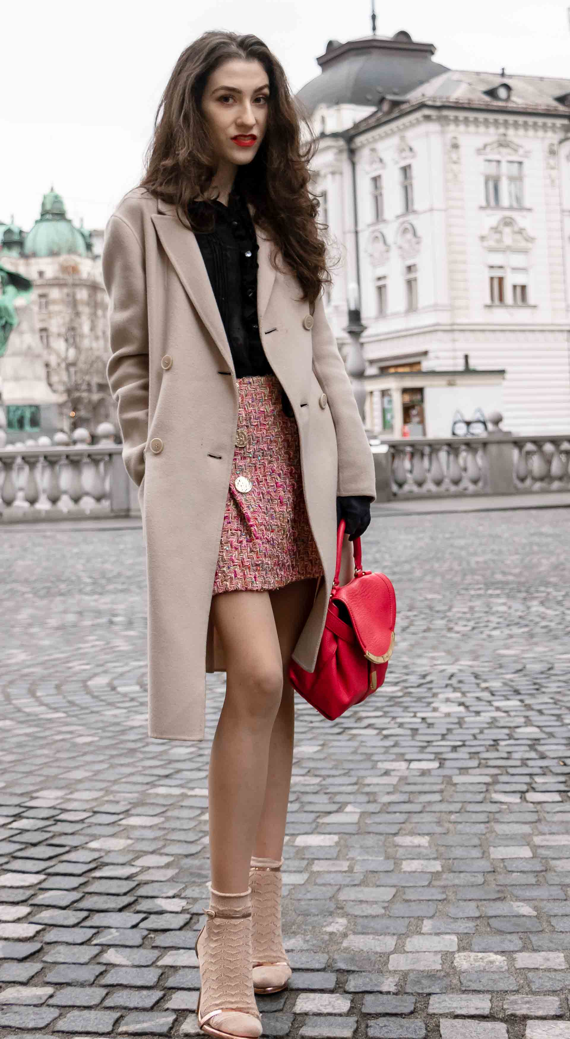 Fashion Blogger Veronika Lipar of Brunette from Wall Street wearing bronze socks and high shine rose gold Songnudist sandals from Stuart Weitzman, tweed Storets mini skirt, black blouse, off white Weekend Maxmara coat while on the street in Ljubljana