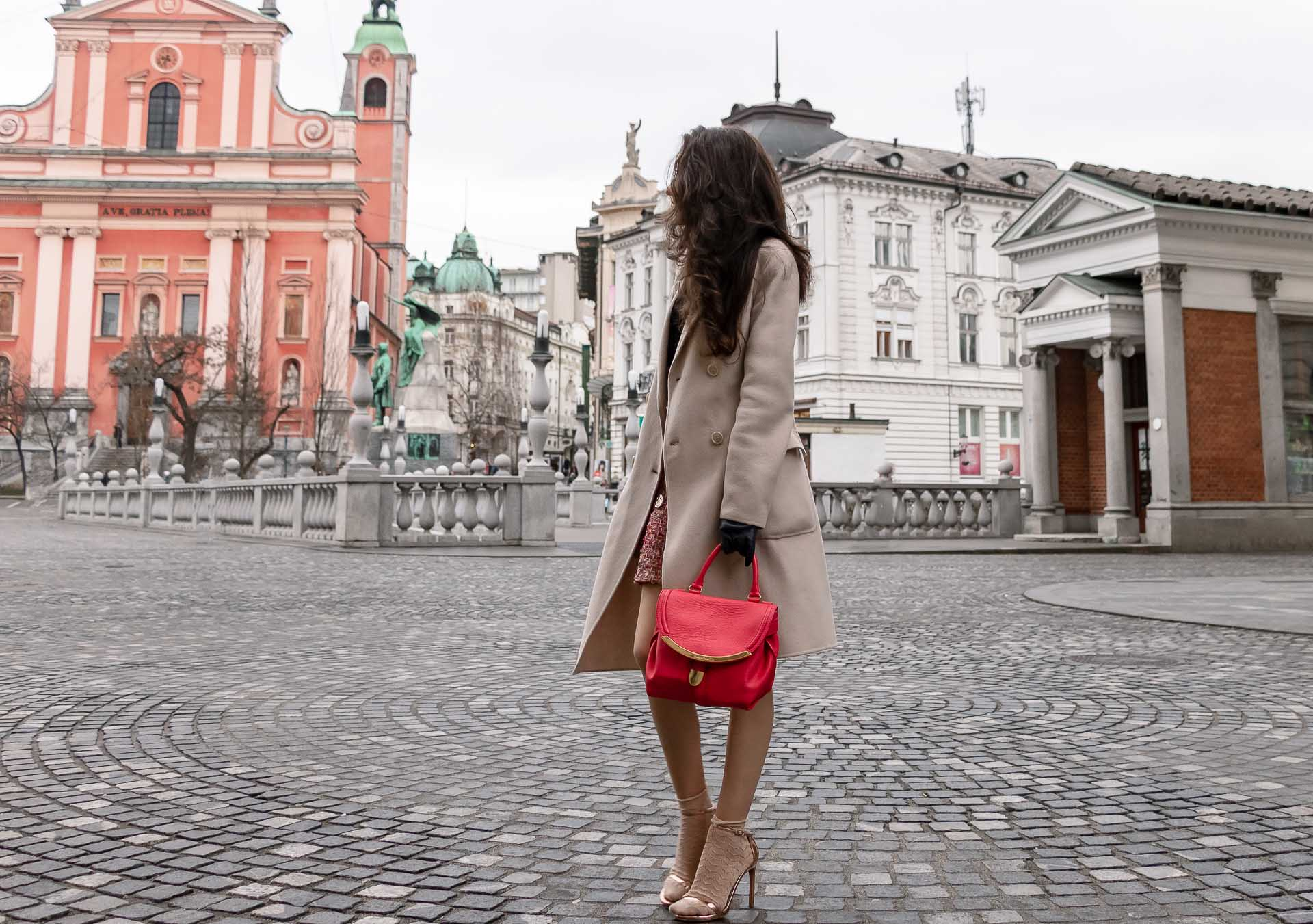 Fashion Blogger Veronika Lipar of Brunette from Wall Street dressed in bronze socks and high shine rose gold Songnudist sandals from Stuart Weitzman, tweed Storets mini skirt, black blouse, off white Weekend Maxmara coat in Ljubljana