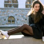 Fashion Blogger Veronika Lipar of Brunette from Wall Street wearing black Escada cape, black mini skirt and white sneakers from Diesel with black polka dot tights and white shoulder chain bag and blue leather gloves for a day out