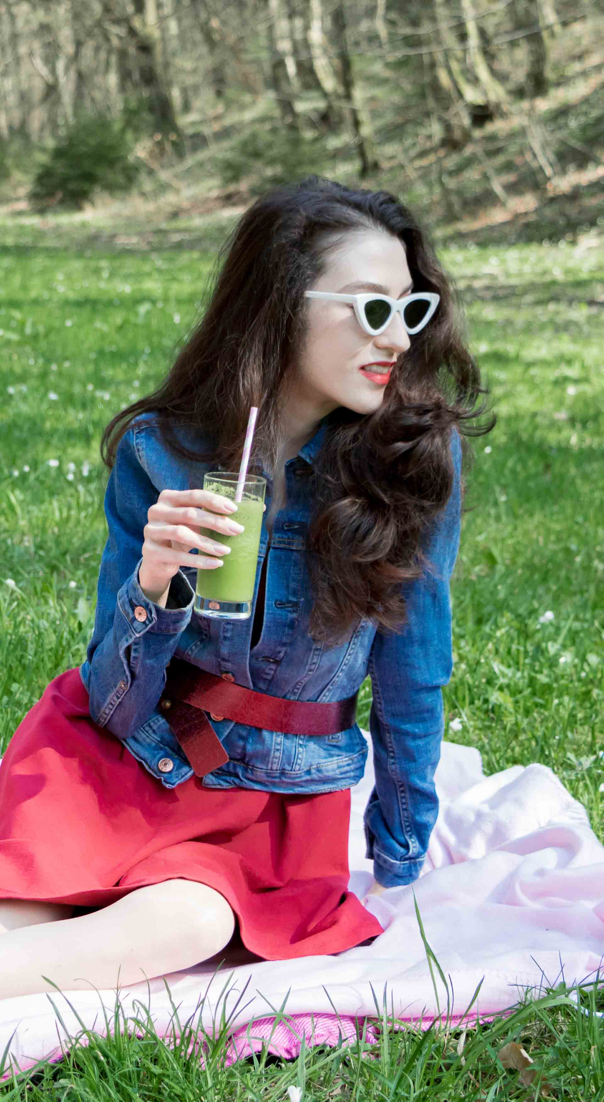 Veronika Lipar Fashion Blogger of Brunette from Wall Street wearing red dress, dangling belt, blue denim jacket, white socks and white pumps, Sam Eldeman x Le Specs, white lolita cat-eye sunglasses, Nannacay raffia basket bag for spring picnic