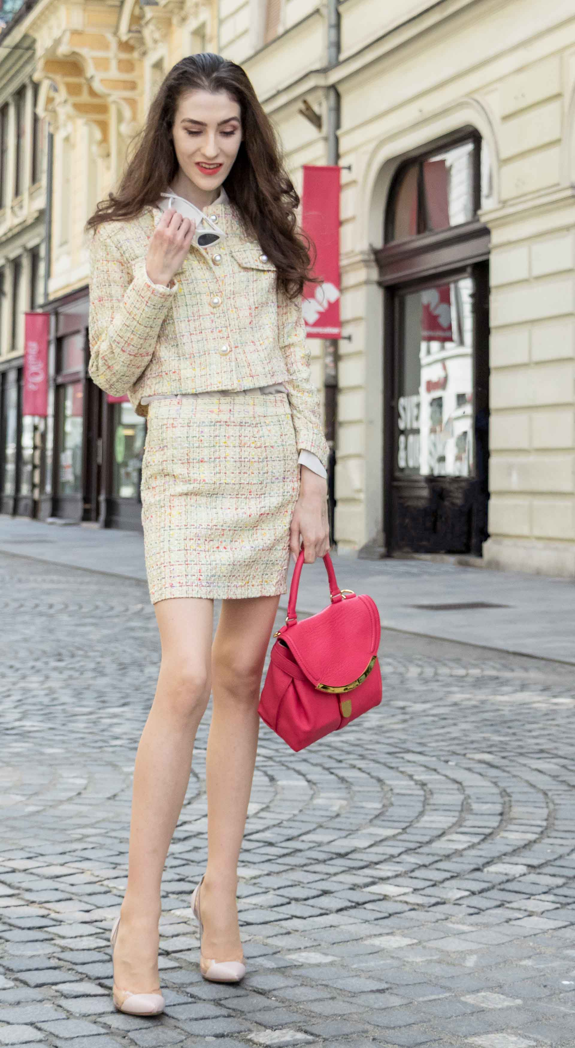 Fashion Blogger Veronika Lipar of Brunette from Wall Street wearing Storets yellow tweed mini skirt suit, Gianvito Rossi plexi pumps, See by Chloe pink top handle bag on the streets in Ljubljana