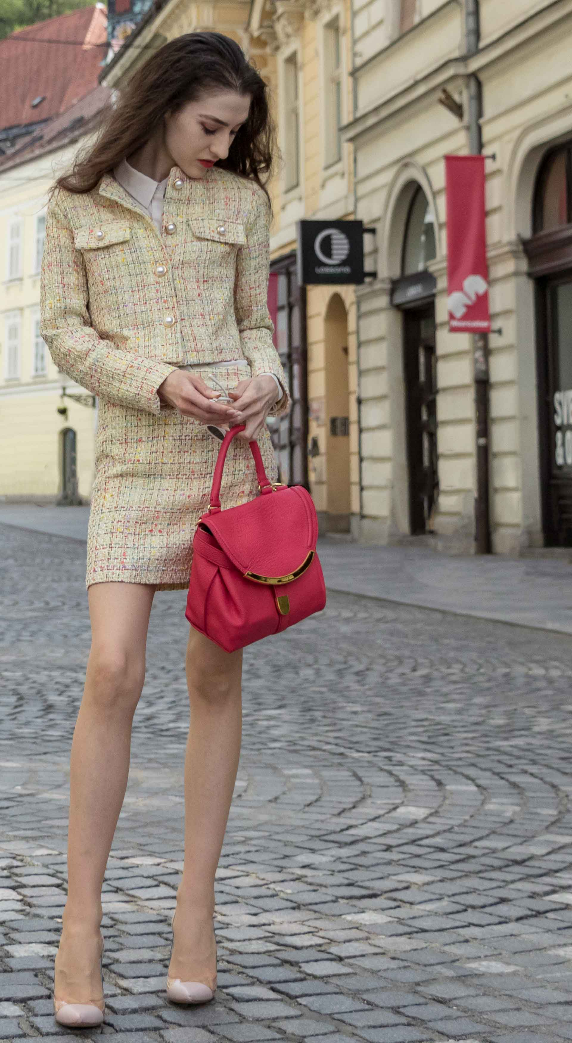 Fashion Blogger Veronika Lipar of Brunette from Wall Street dressed in Storets yellow tweed mini skirt suit, Gianvito Rossi plexi pumps, See by Chloe pink top handle bagfor doctor's appointment