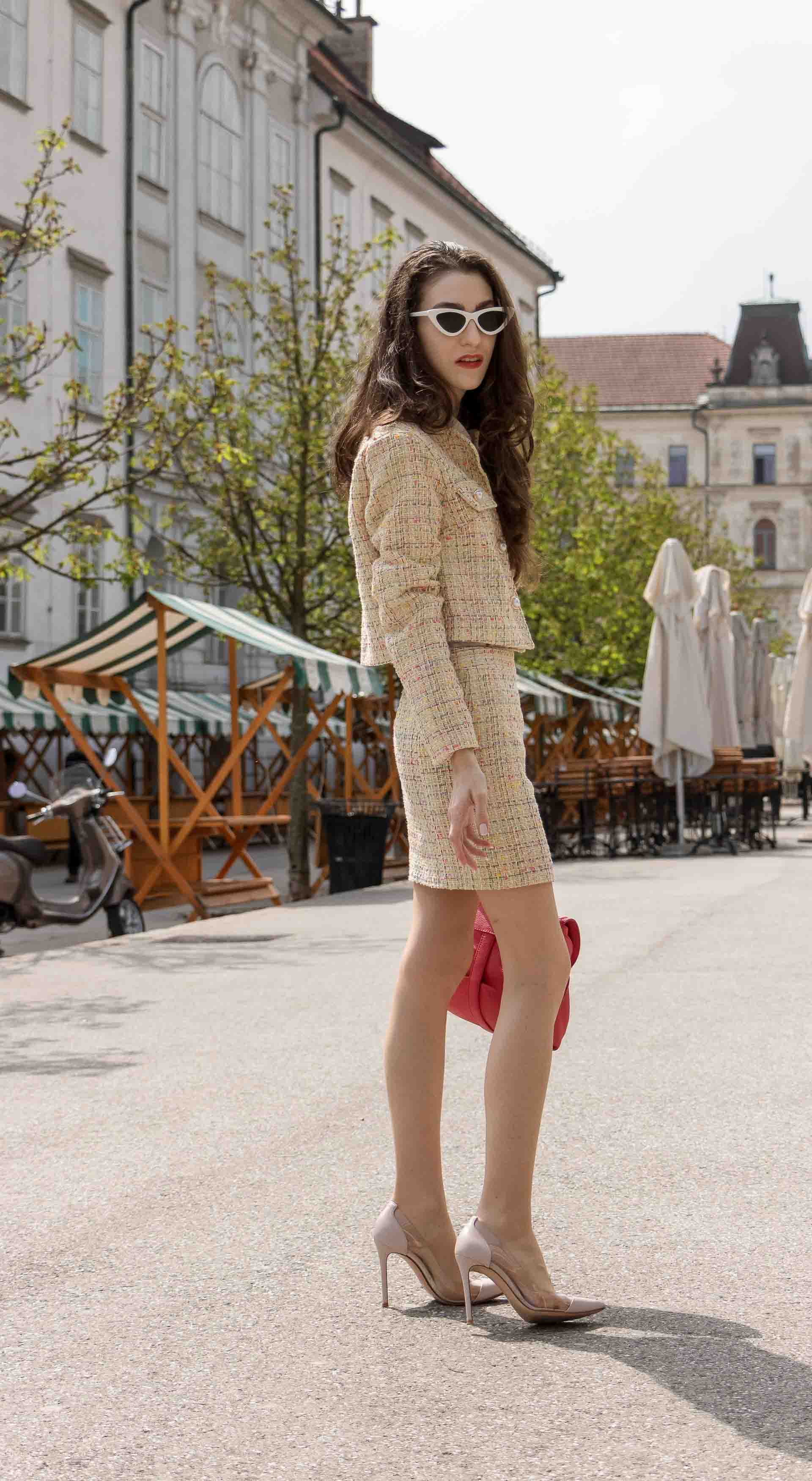 Fashion Blogger Veronika Lipar of Brunette from Wall Street dressed in Storets yellow tweed mini skirt suit, Gianvito Rossi plexi pumps, See by Chloe pink top handle bag