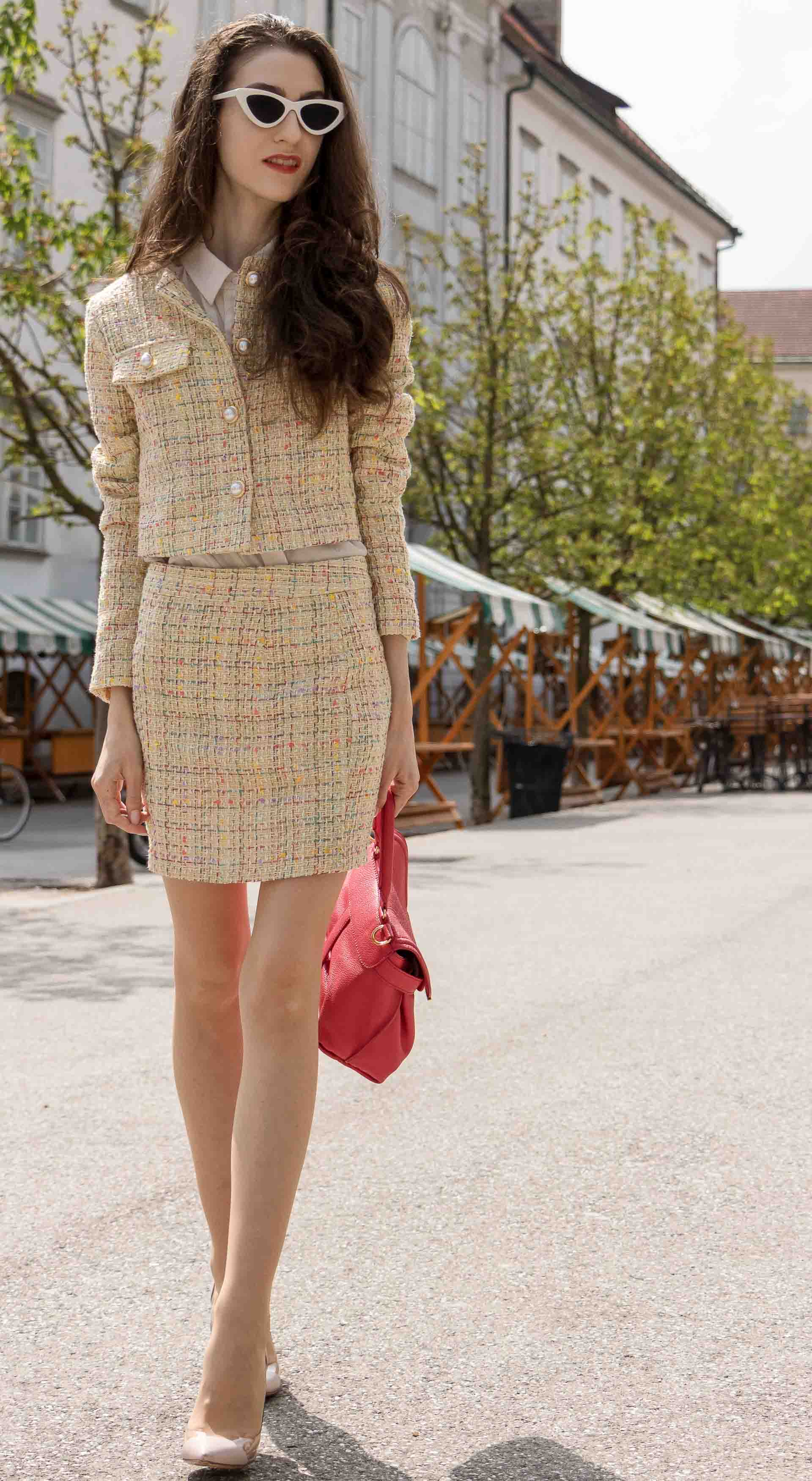 Fashion Blogger Veronika Lipar of Brunette from Wall Street wearing Storets yellow tweed mini skirt suit, Gianvito Rossi plexi pumps, See by Chloe pink top handle bag, Adam Selman x Lespecs white Lolita sunglasses on the street in Ljubljana