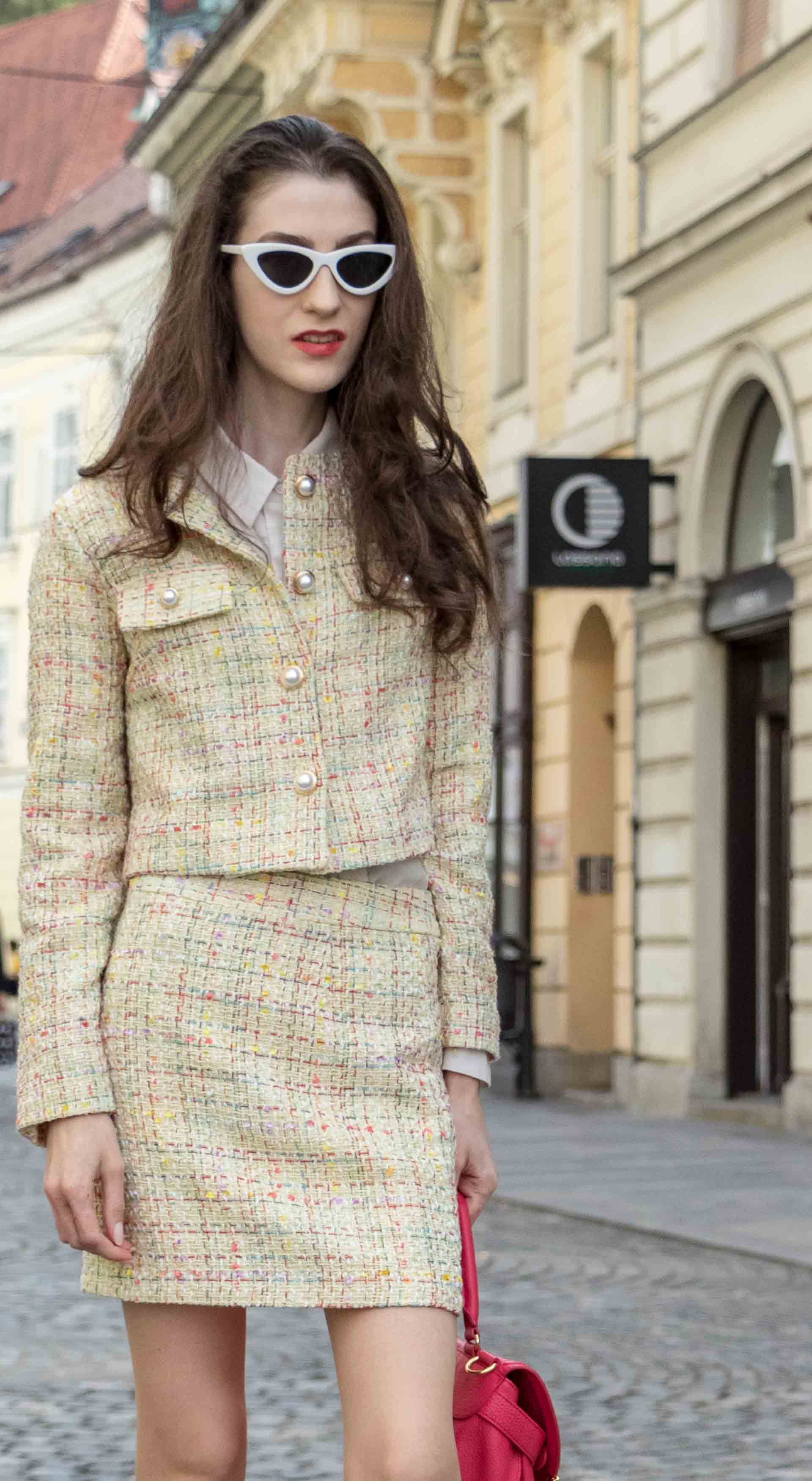 Fashion Blogger Veronika Lipar of Brunette from Wall Street wearing Storets yellow tweed mini skirt suit, See by Chloe pink top handle bag, Adam Selman x Lespecs white Lolita sunglasses for spring brunch