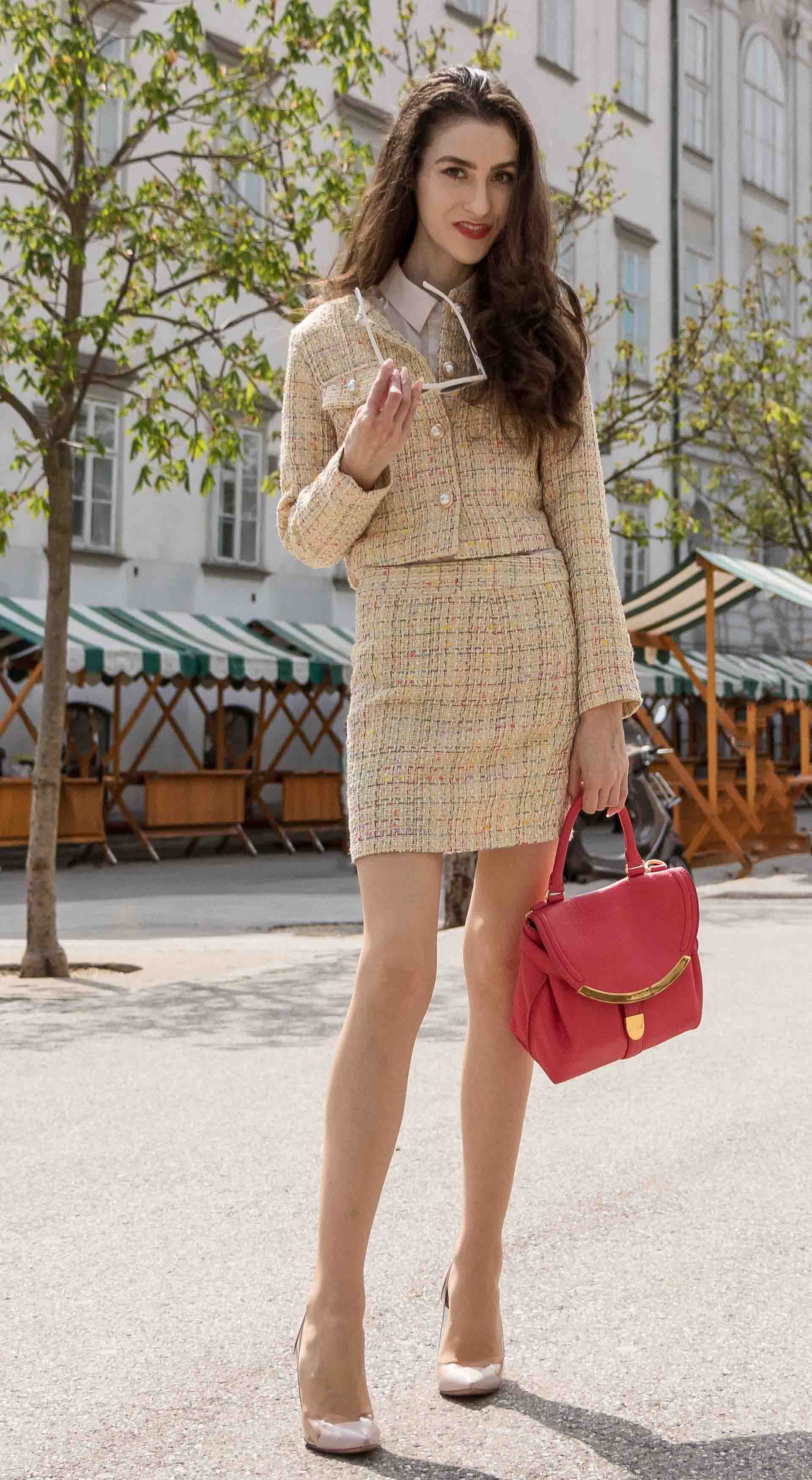 Fashion Blogger Veronika Lipar of Brunette from Wall Street dressed in Storets yellow tweed mini skirt suit, Gianvito Rossi plexi pumps, See by Chloe pink top handle bag on the street in Ljubljana