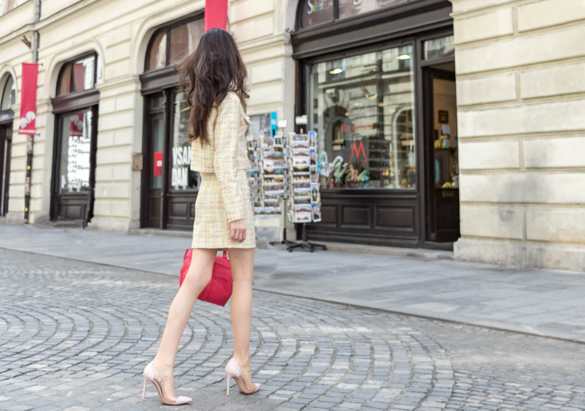Fashion Blogger Veronika Lipar of Brunette from Wall Street wearing Storets yellow tweed mini skirt suit, Gianvito Rossi plexi pumps, See by Chloe pink top handle bag, Adam Selman x Lespecs white Lolita sunglasses on the streets in Ljubljana