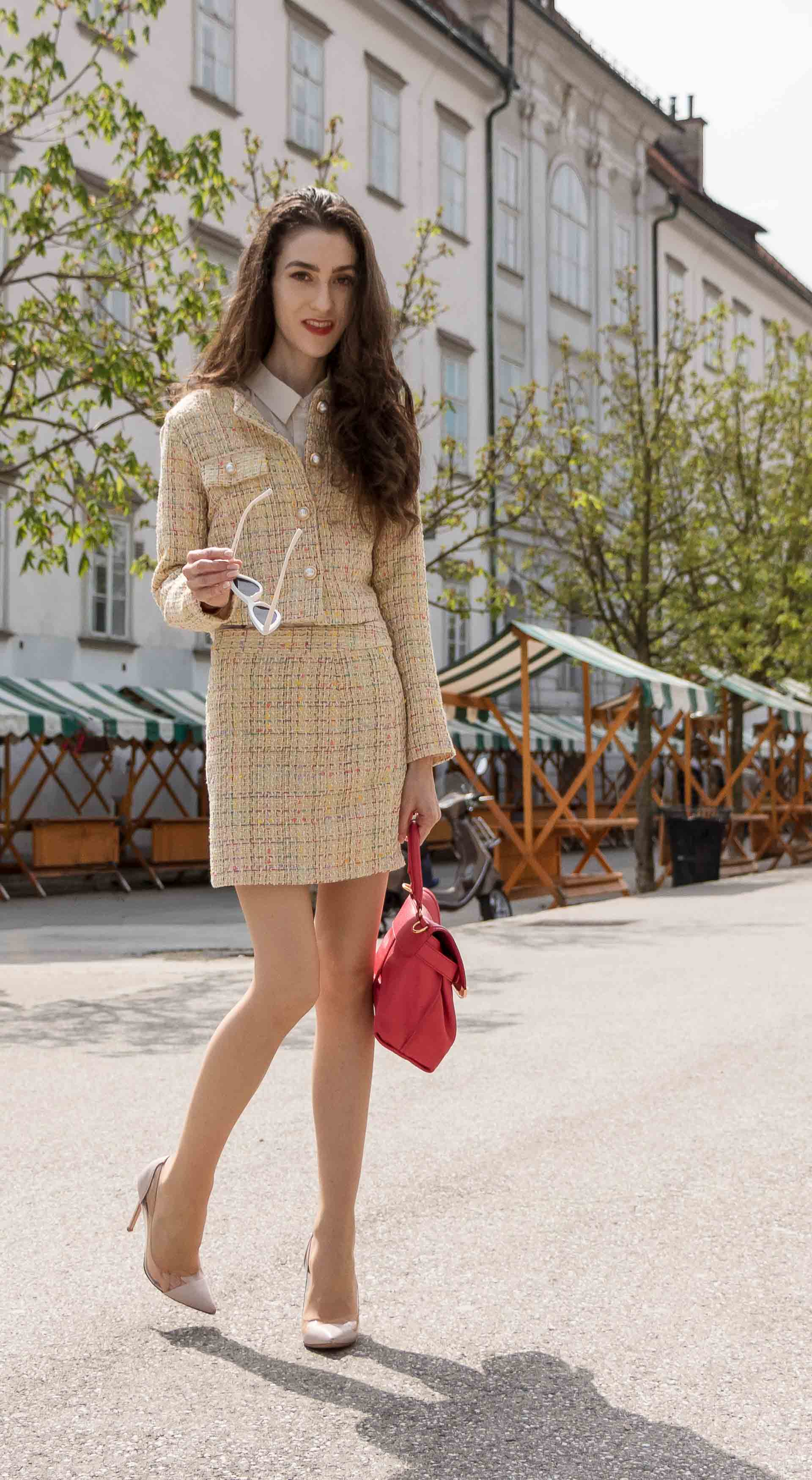 Fashion Blogger Veronika Lipar of Brunette from Wall Street dressed in Storets yellow tweed mini skirt suit, Gianvito Rossi plexi pumps, See by Chloe pink top handle bag, Adam Selman x Lespecs white Lolita sunglasses for spring