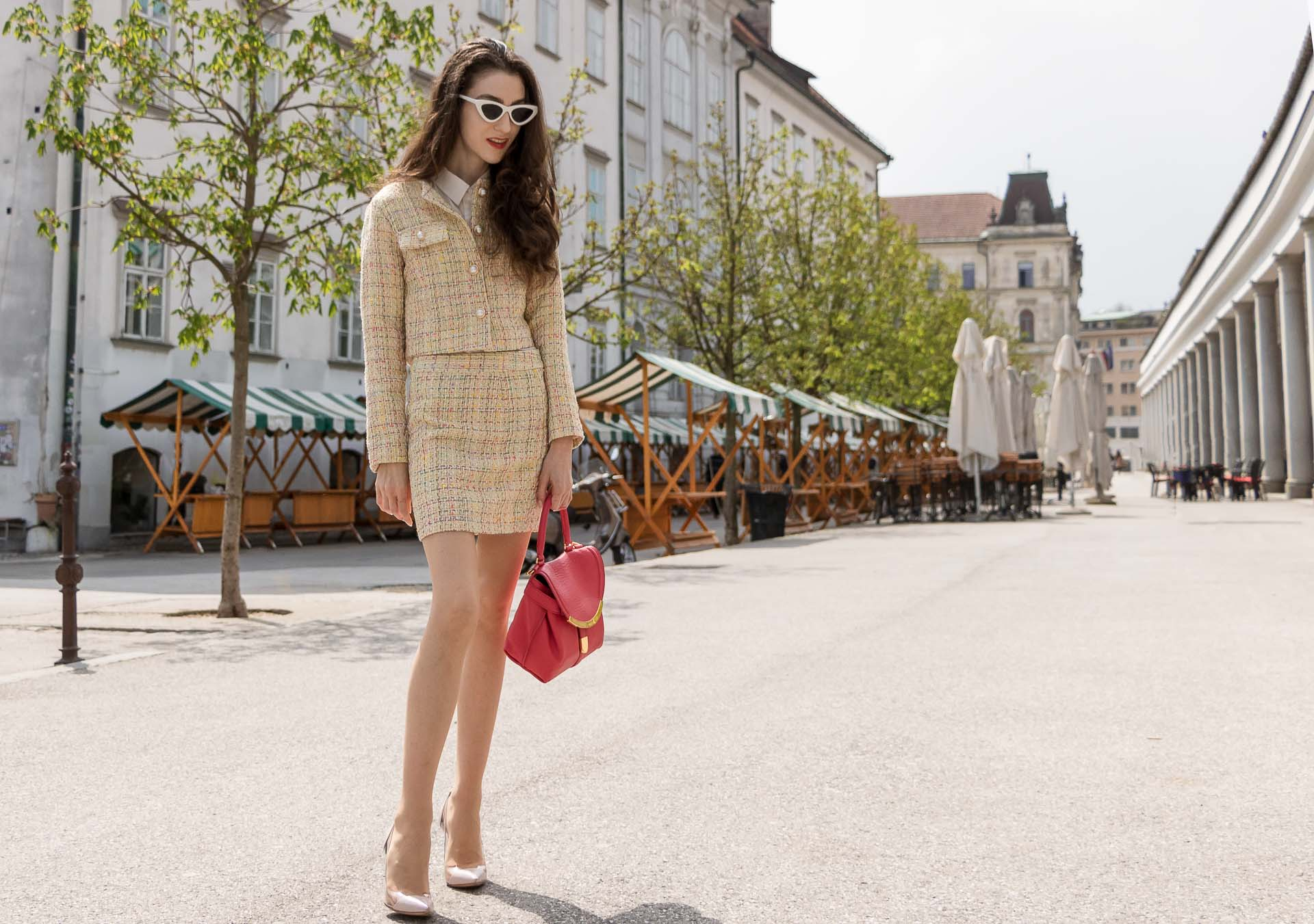 Fashion Blogger Veronika Lipar of Brunette from Wall Street wearing Storets yellow tweed mini skirt suit, Gianvito Rossi plexi pumps, See by Chloe pink top handle bag in Ljubljana