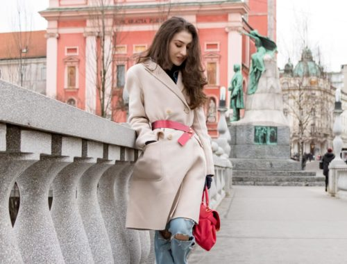 Fashion Blogger Veronika Lipar of Brunette from Wall Street wearing distressed blue Levi's jeans, off-white double breasted Weekend Maxmara coat, See by Chloe pink top handle bag, blue leather gloves on the street of Ljubljana