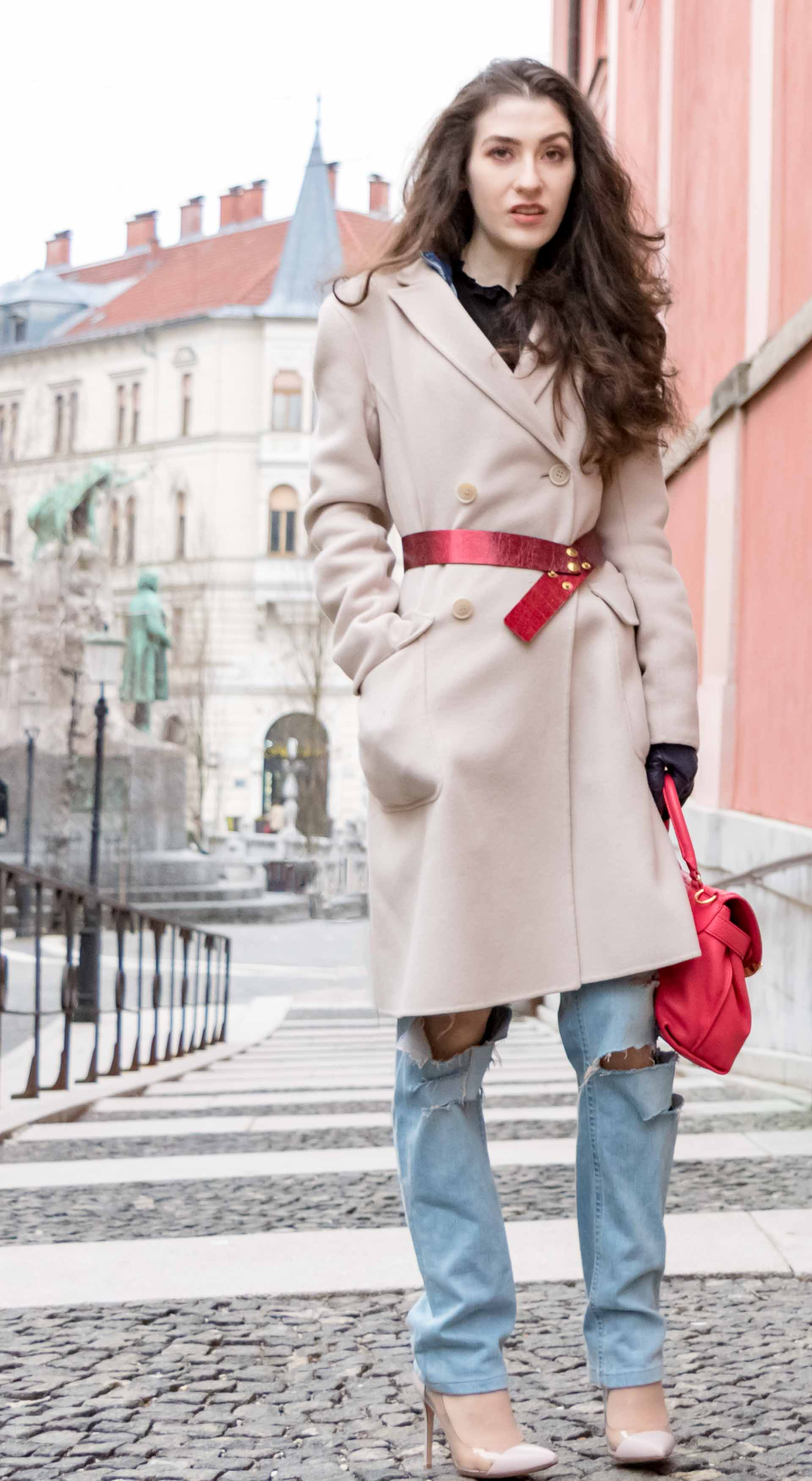Fashion Blogger Veronika Lipar of Brunette from Wall Street wearing distressed blue Levi's jeans, off-white double breasted Weekend Maxmara coat, red dangling belt, blush Gianvito Rossi plexi pumps, See by Chloe pink top handle bag, blue leather gloves on the street of Ljubljana
