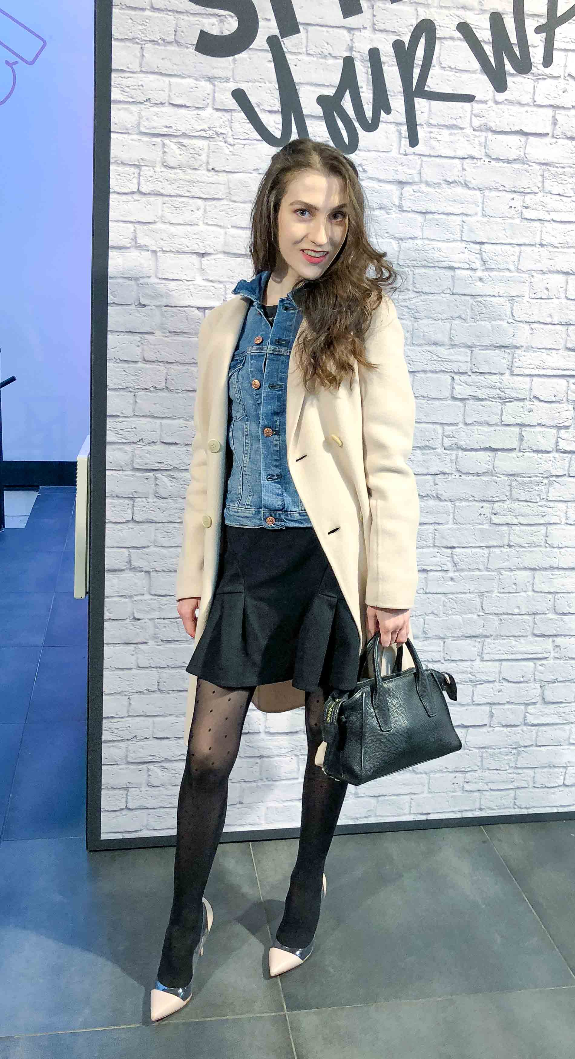 Fashion Blogger Veronika Lipar of Brunette from Wall Street wearing off-white Weekend Maxmara coat, blue denim jacket, polka-dot black sheer tights, blush plexi shoes from Gianvito Rossi, black mini skirt for Paris during Paris fashion week fall winter 2018/19
